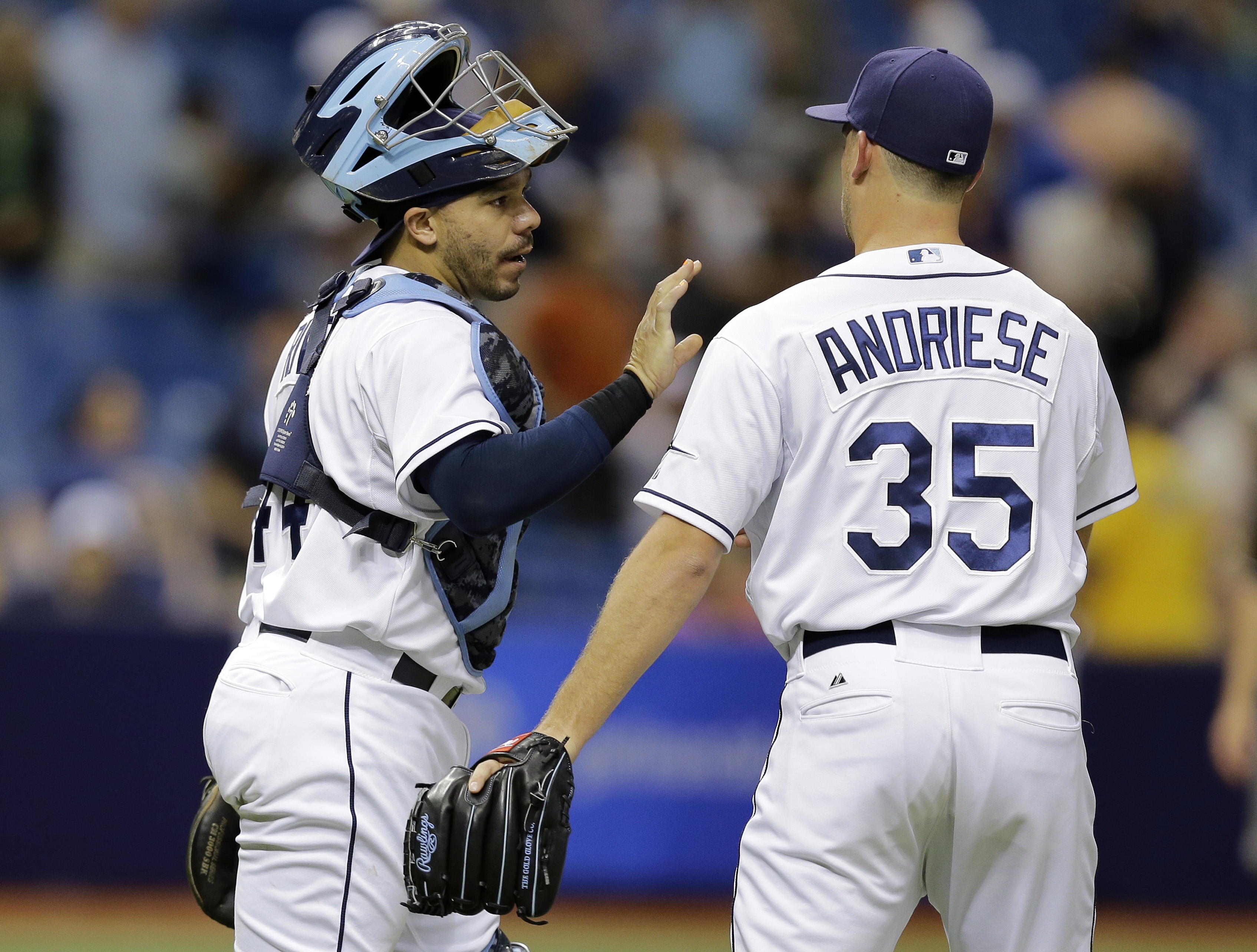 Tampa Bay Rays catcher Rene Rivera, left, congratulates relief pitcher Matt Andriese after closing out the New York Yankees during the ninth inning of a baseball game Thursday, May 14, 2015, in St. Petersburg, Fla. The Rays won 6-1. (AP Photo/Chris O'Mear
