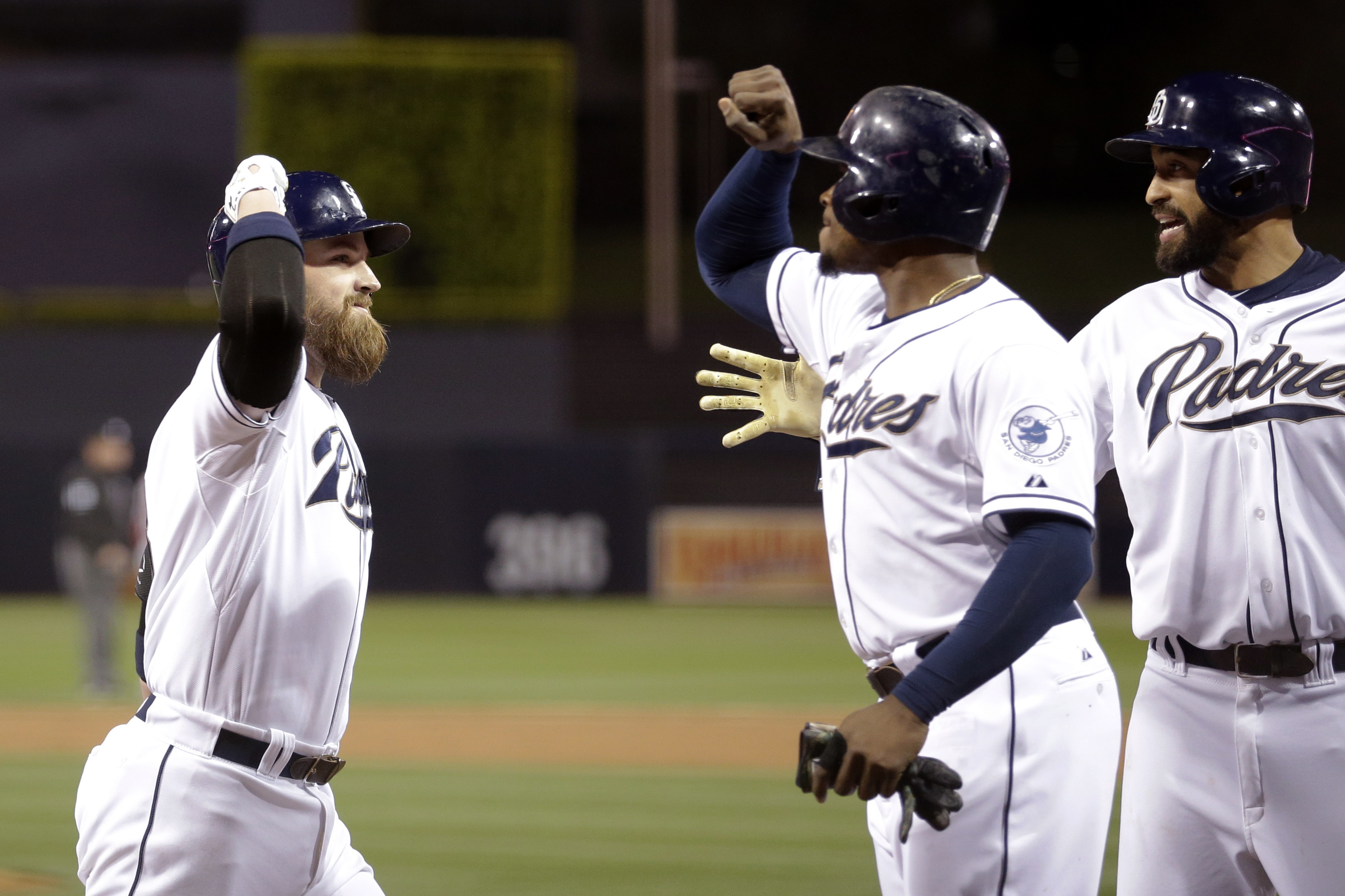 San Diego Padres' Derek Norris, left, is greeted by teammates after hitting a three-run home run, driving in Matt Kemp, right, and Justin Upton, center, against the Washington Nationals during the first inning in a baseball game Thursday, May 14, 2015, in