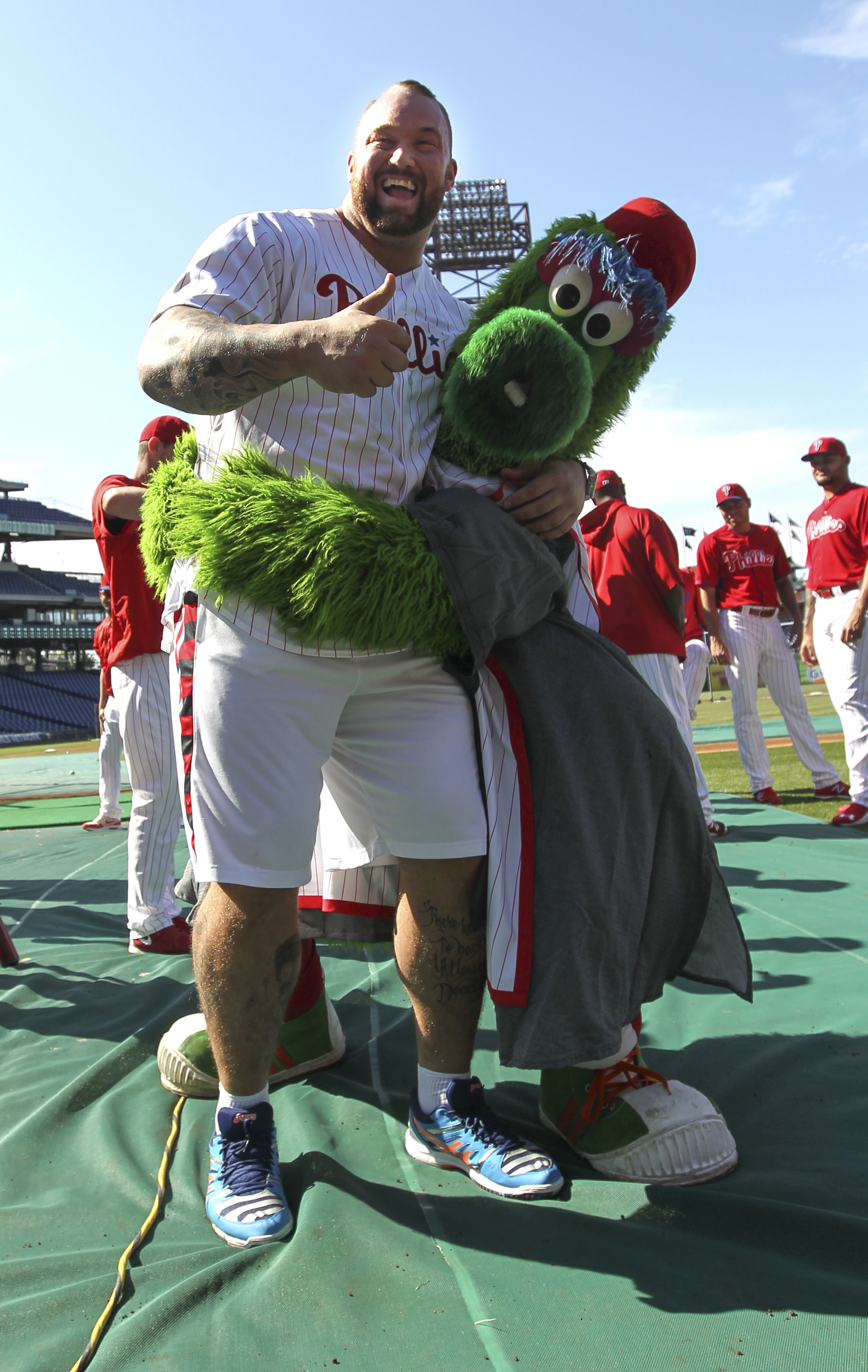 "Actor Hafthor Julius Bjornsson, left, who plays Gregor Clegane also known as ""The Mountain"" on ""Game of Thrones, clowns around with the Philadelphia Phillies Phanatic before a baseball game against the Arizona Diamondbacks, Friday, May 15, 2015, in Philad"