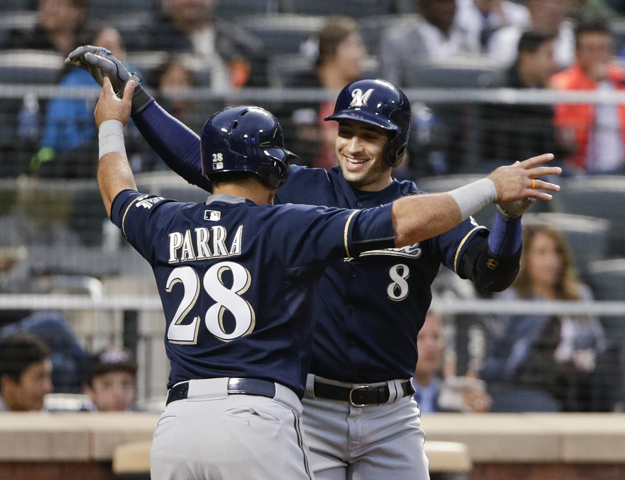 Milwaukee Brewers' Ryan Braun (8) celebrates with teammate Gerardo Parra (28) after hitting a two -un home run during the third inning of a baseball game against the New York Mets on Friday, May 15, 2015, in New York. (AP Photo/Frank Franklin II)