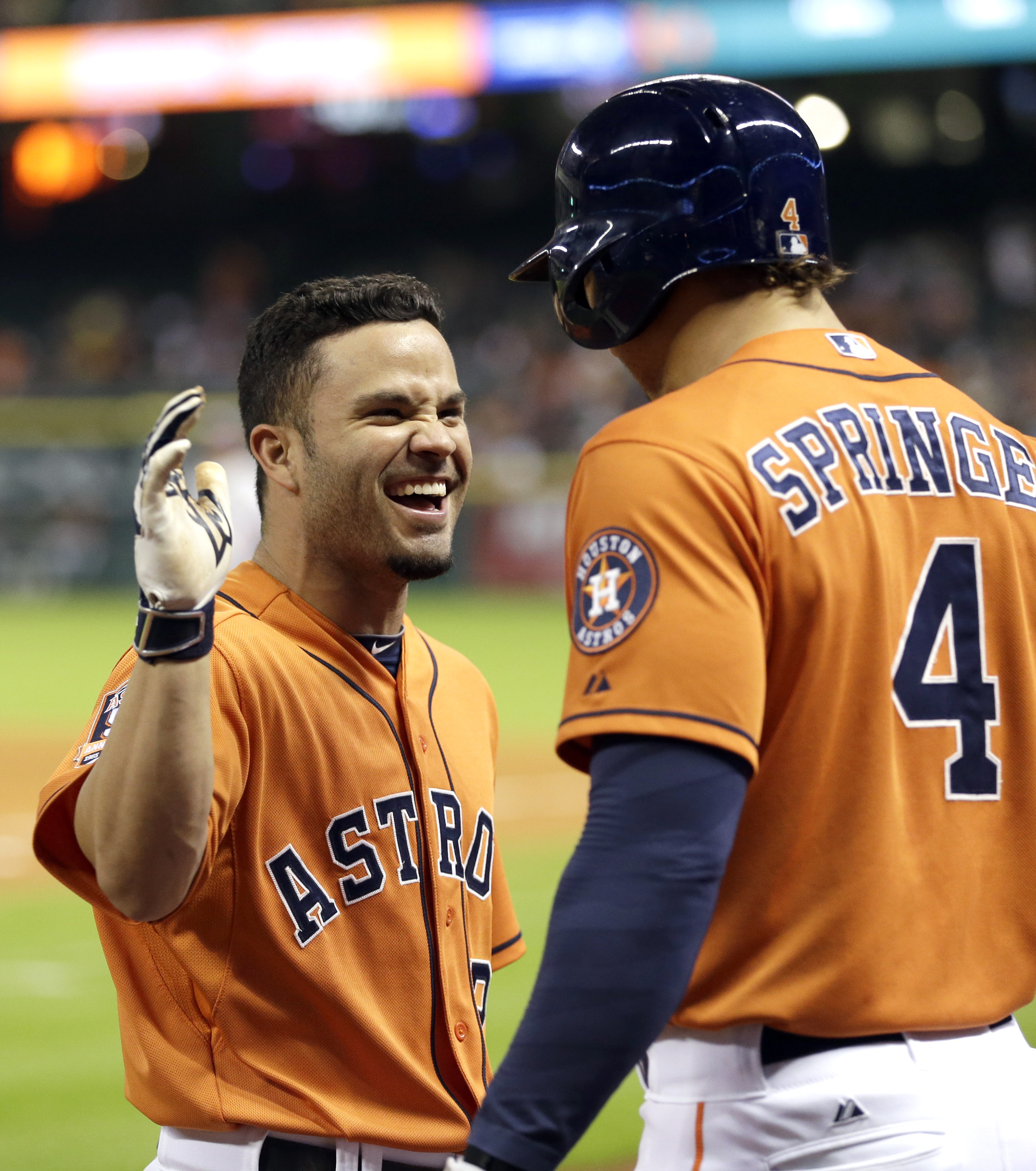 Houston Astros' Jose Altuve, left, celebrates his three-run home run with George Springer (4) during the fourth inning of a baseball game against the Toronto Blue Jays Friday, May 15, 2015, in Houston. (AP Photo/David J. Phillip)