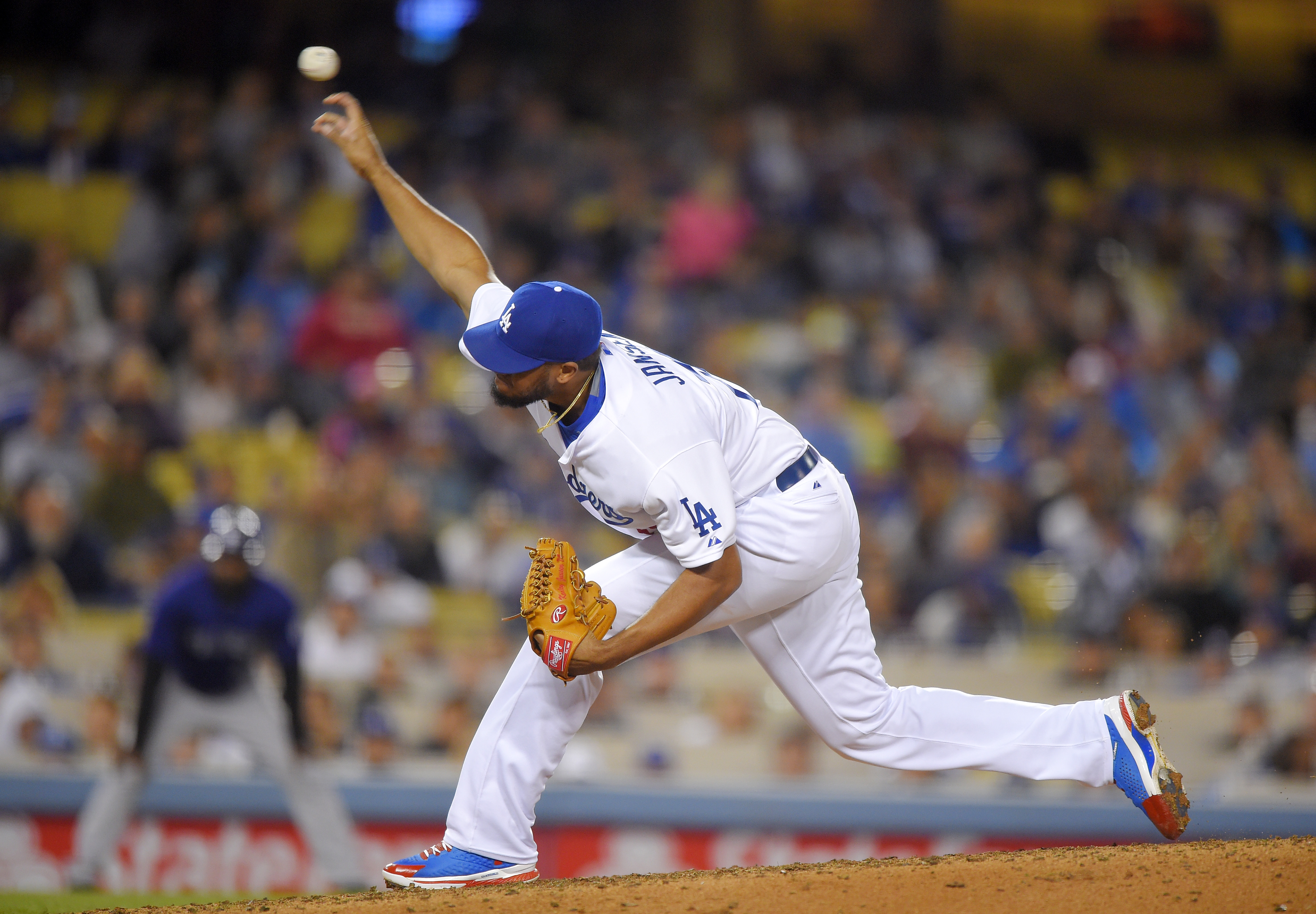 Los Angeles Dodgers relief pitcher Kenley Jansen throws to the plate during the eighth inning of a baseball game against the Colorado Rockies, Friday, May 15, 2015, in Los Angeles. (AP Photo/Mark J. Terrill)