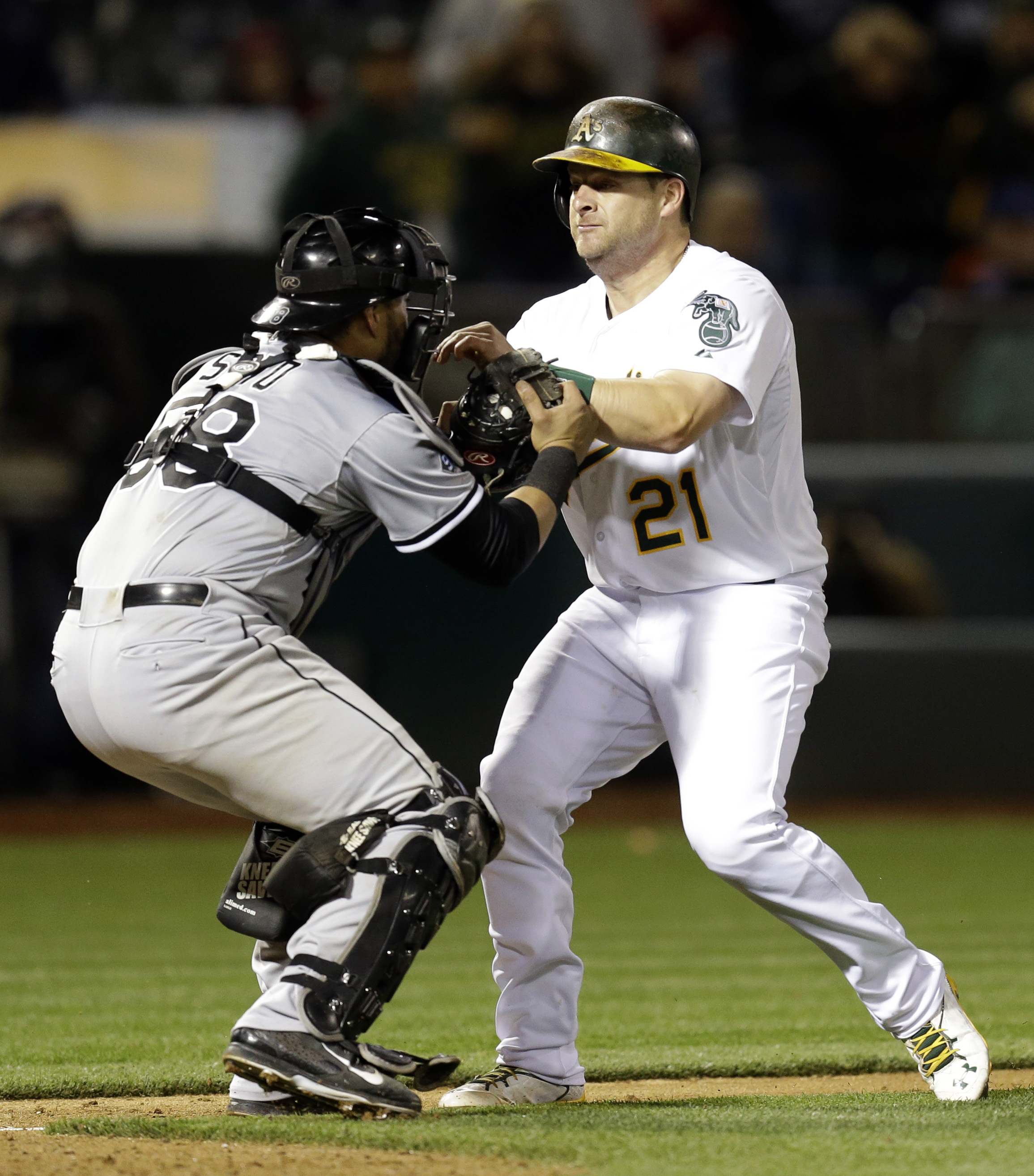 Oakland Athletics' Stephen Vogt, right, is tagged out at home plate by Chicago White Sox catcher Geovany Soto in the ninth inning of a baseball game Friday, May 15, 2015, in Oakland, Calif. Chicago won 7-6. (AP Photo/Ben Margot)