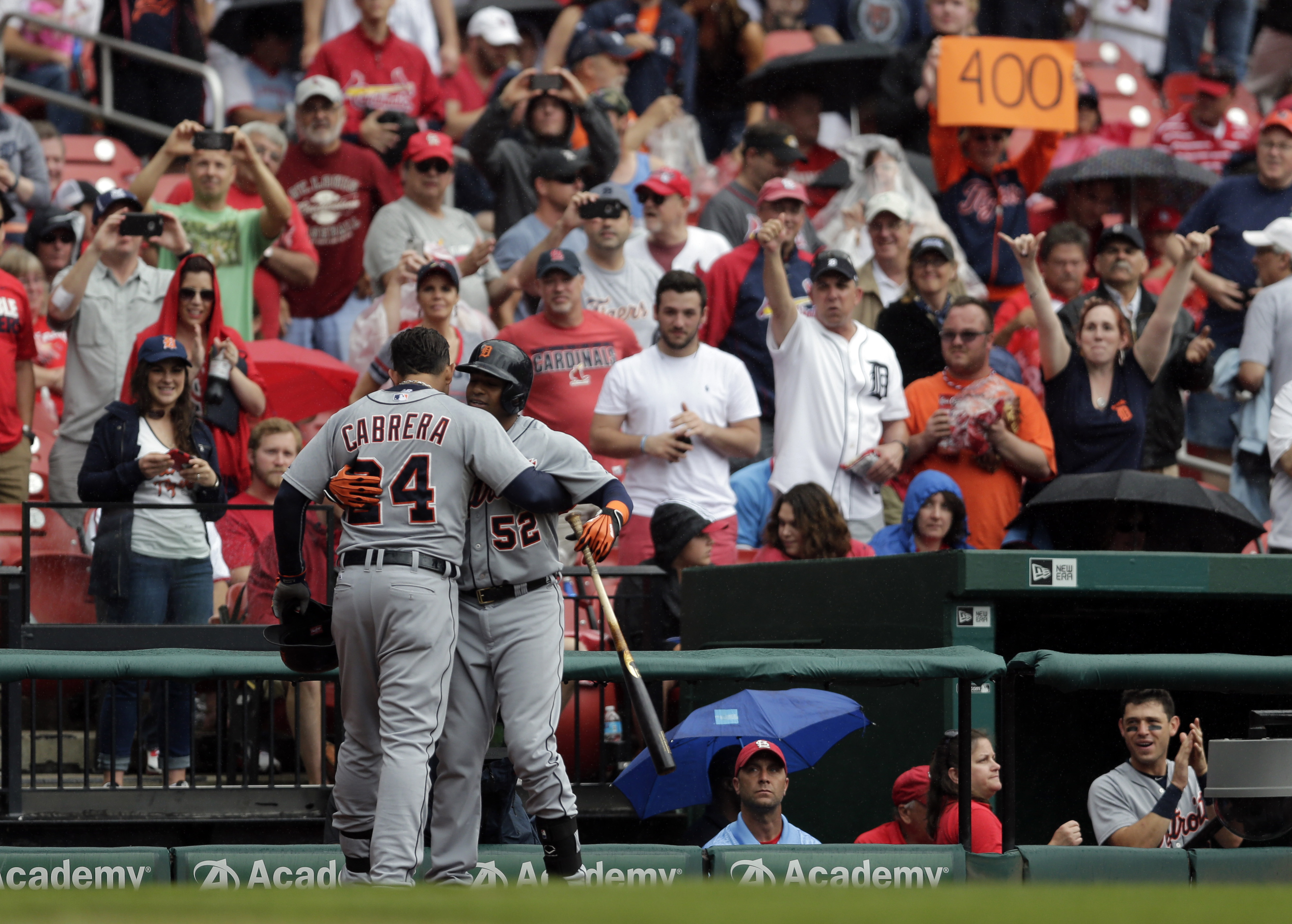 Detroit Tigers' Miguel Cabrera (24) gets a hug from teammate Yoenis Cespedes after hitting a solo home run during the first inning of a baseball game against the St. Louis Cardinals, Saturday, May 16, 2015, in St. Louis. (AP Photo/Jeff Roberson)