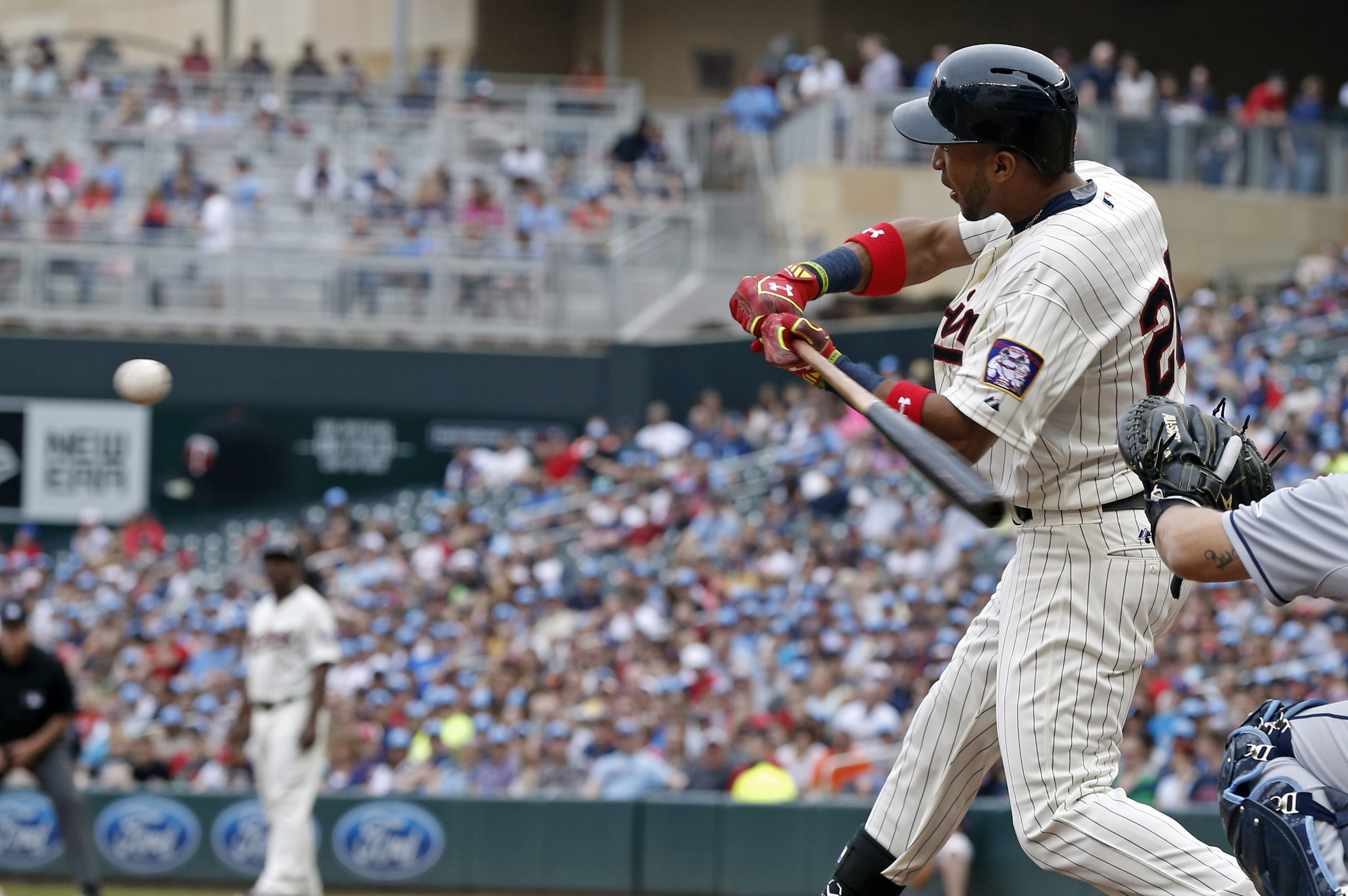 Minnesota Twins' Eddie Rosario swings as the ball comes to him and connects with an RBI single off Tampa Bay Rays pitcher Alex Colome in the second inning of a baseball game, Saturday, May 16, 2015, in Minneapolis. (AP Photo/Jim Mone)