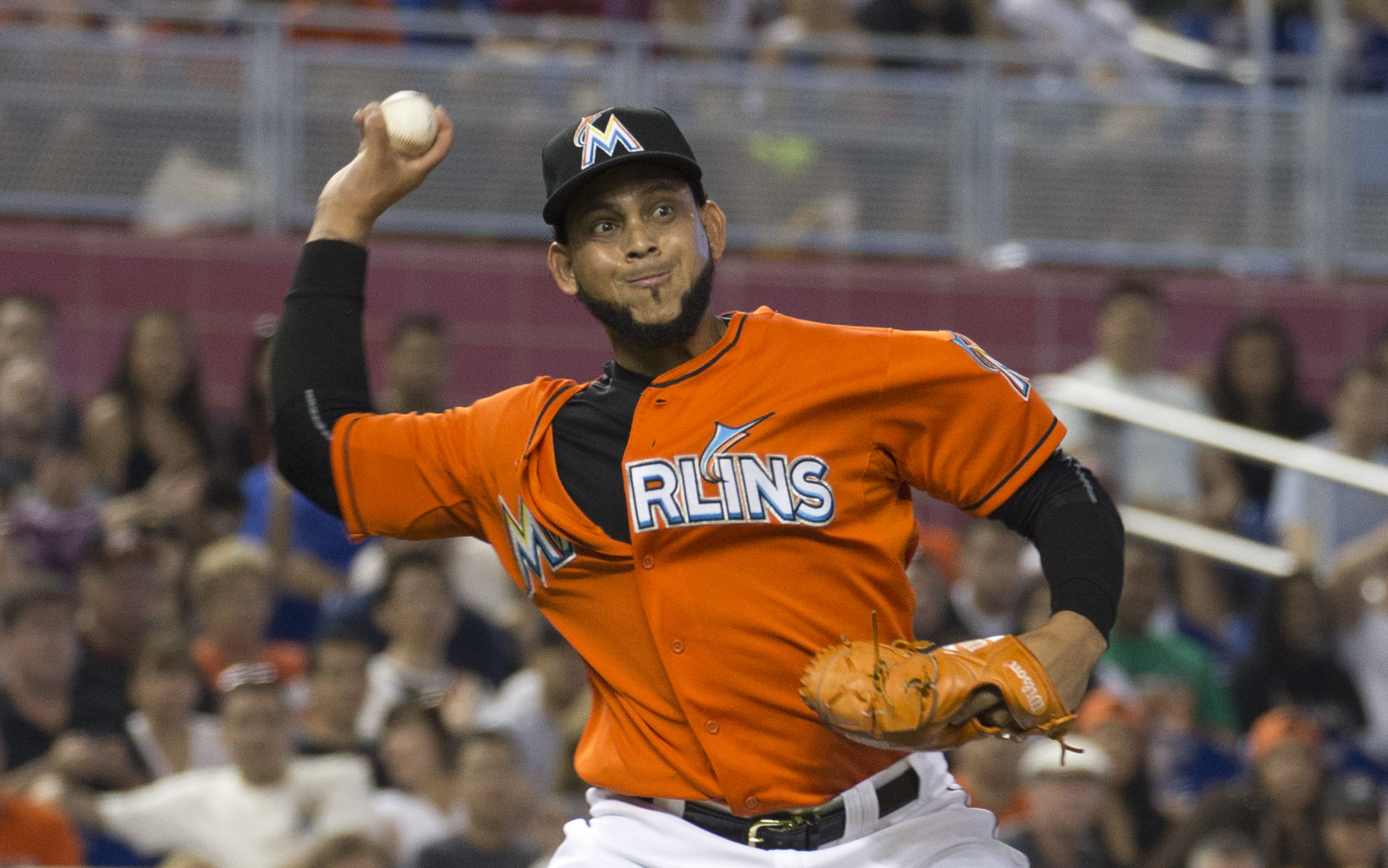 Miami Marlins starting pitcher Henderson Alvarez tries to make a play at first base after being hit by and then dropping the ball during the second inning of a baseball game against the Atlanta Braves in Miami, Sunday, May 17, 2015. (AP Photo/J Pat Carter