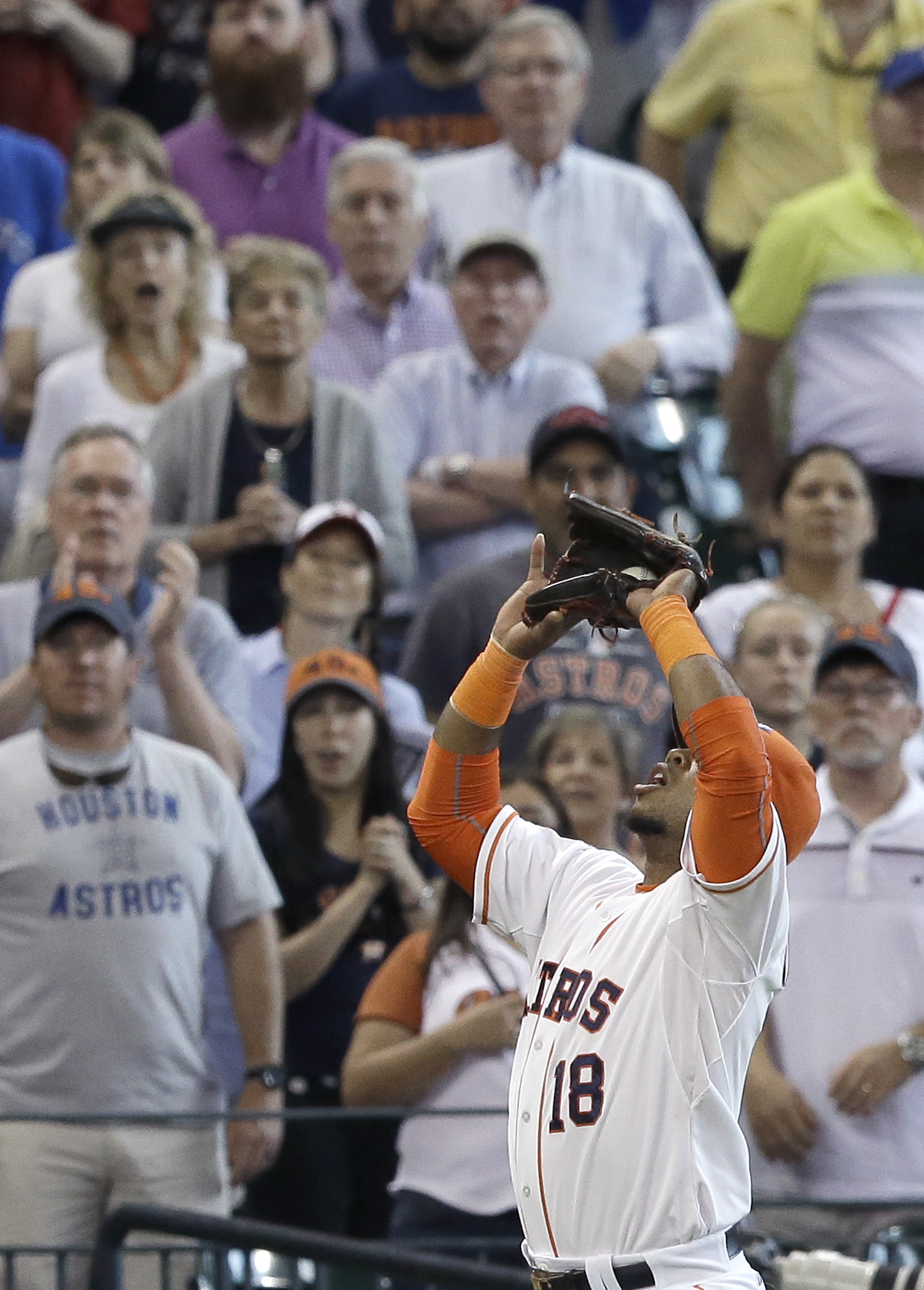 Houston Astros third baseman Luis Valbuena (18) makes the catch and the out on Toronto Blue Jays' Ezequiel Carrera to end the baseball game, Sunday, May 17, 2015, in Houston. The Astros won 4-2. (AP Photo/Pat Sullivan)