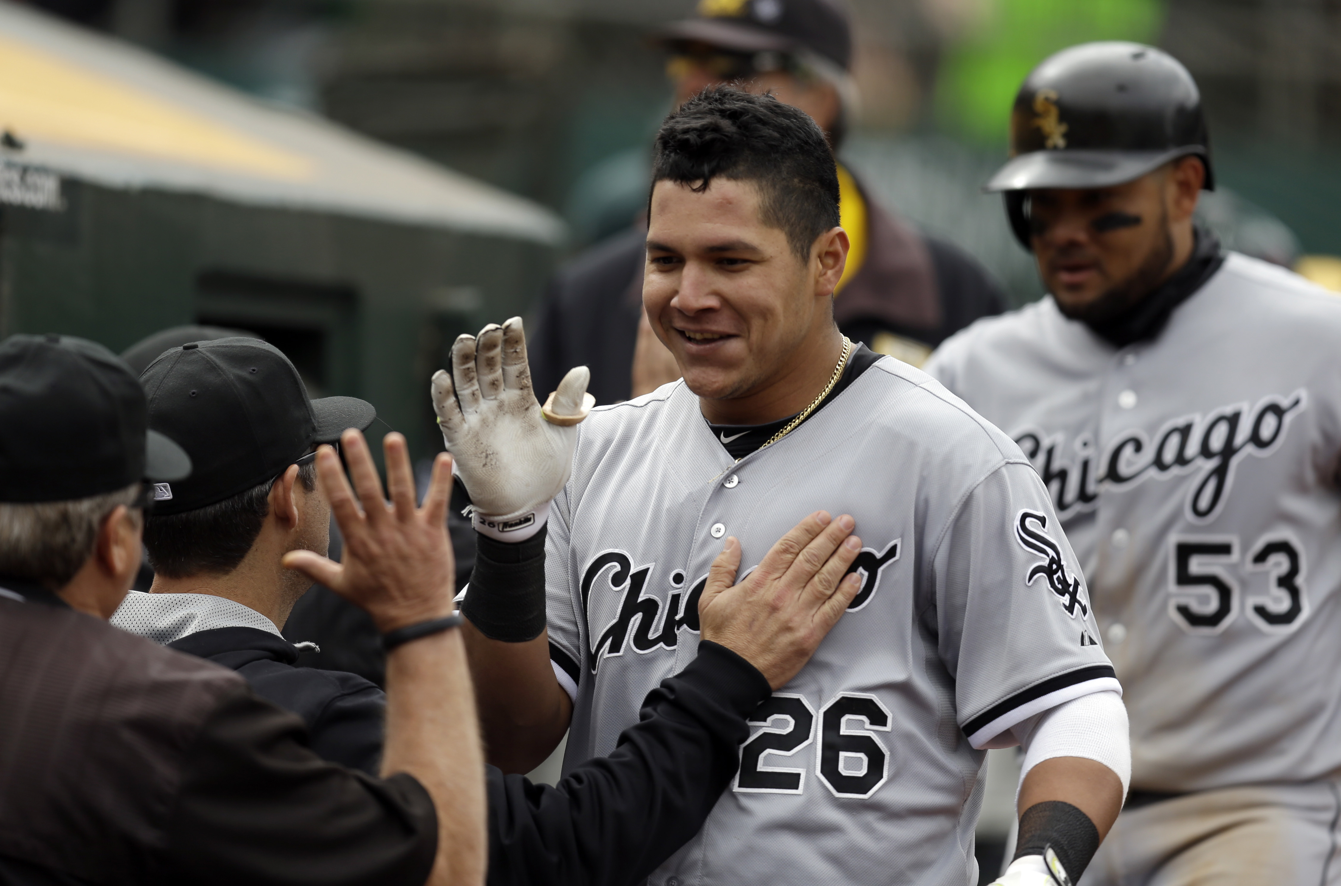 Chicago White Sox's Avisail Garcia (26) is congratulated upon returning to the dugout after hitting a two-run home run off Oakland Athletics' Tyler Clippard in the ninth inning of a baseball game Sunday, May 17, 2015, in Oakland, Calif. White Sox's Melky