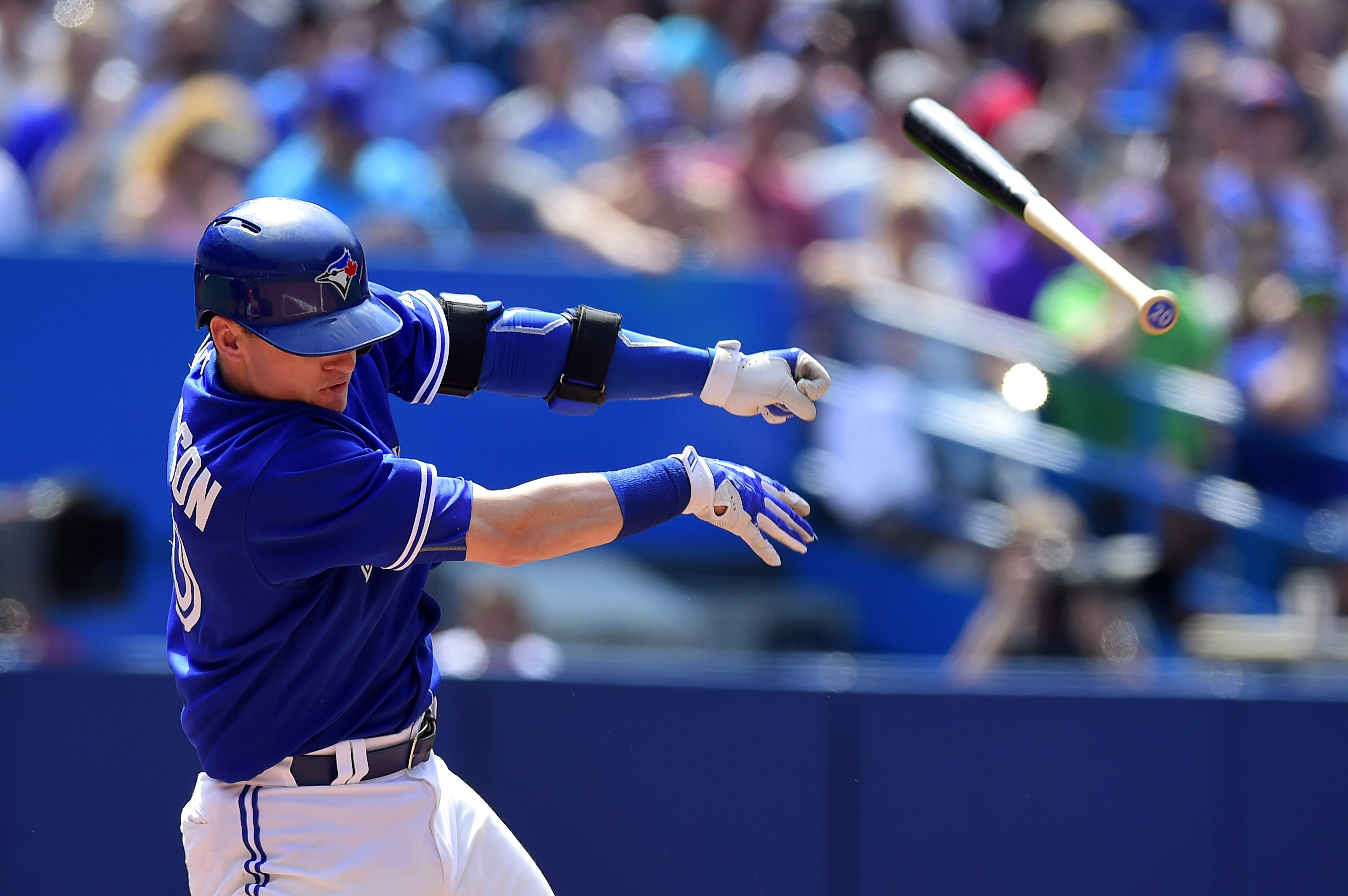 Toronto Blue Jays' Josh Donaldson strikes out swinging and loses control of his bat during the sixth inning of a baseball game against the Los Angeles Angels in Toronto, Monday, May 18, 2015. (Frank Gunn/The Canadian Press via AP)