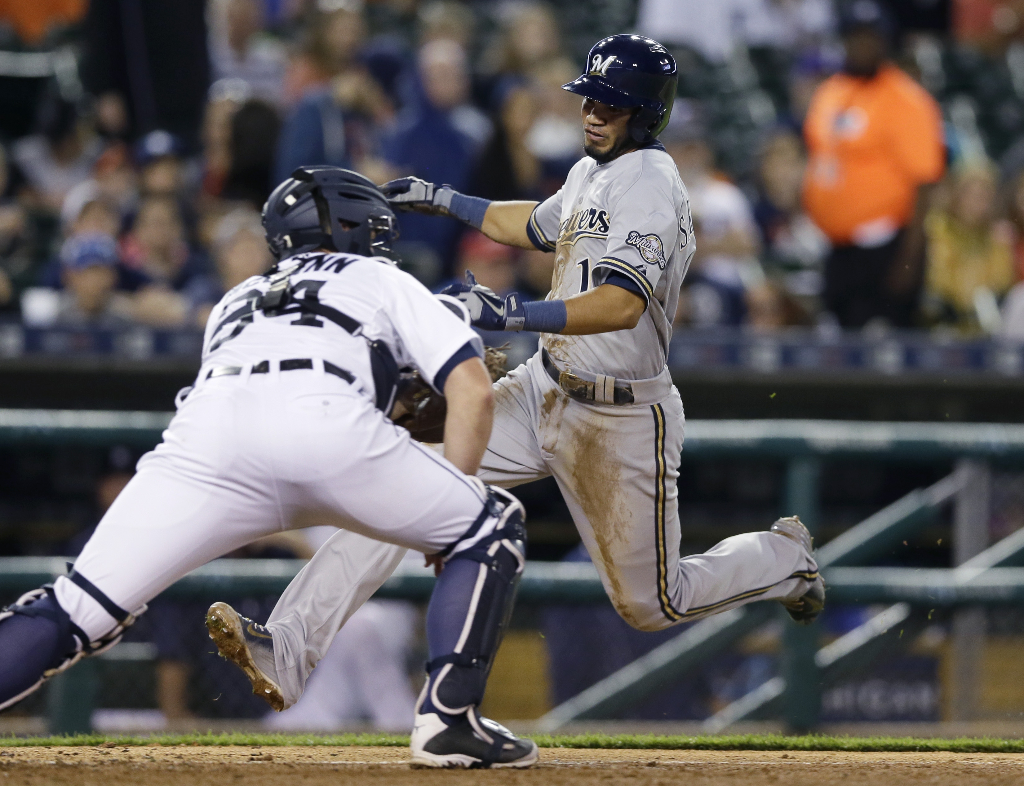 Milwaukee Brewers' Luis Sardinas beats the tag of Detroit Tigers catcher James McCann to score on a single by teammate Carlos Gomez during the seventh inning of an interleague baseball game, Monday, May 18, 2015, in Detroit. (AP Photo/Carlos Osorio)