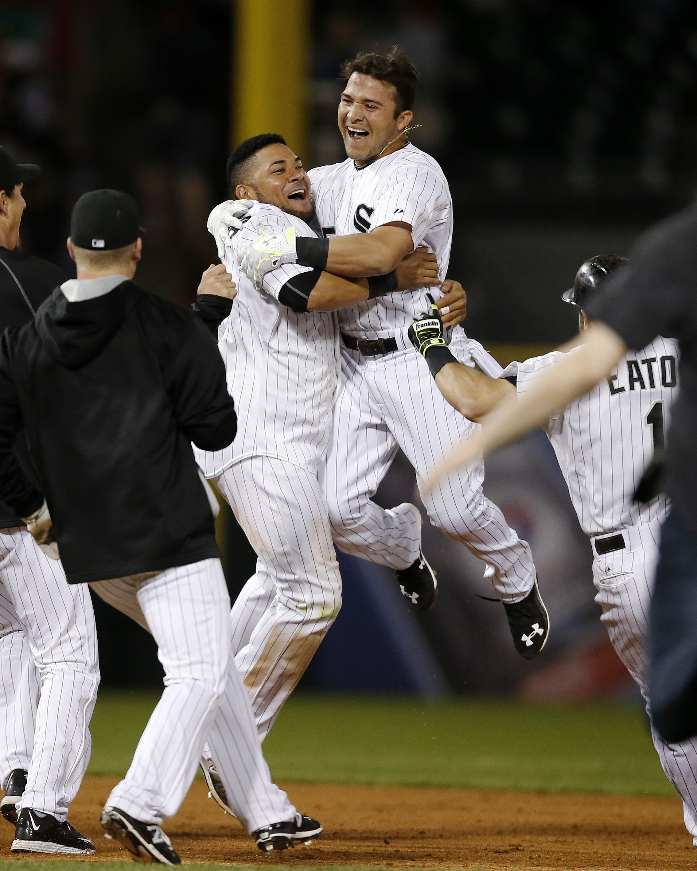 Chicago White Sox's Carlos Sanchez, right, celebrates with Melky Cabrera, left, after hitting in the game-winning run during the tenth inning of a baseball game against the Cleveland Indians Monday, May 18, 2015, in Chicago. The Chicago White Sox won 2-1.