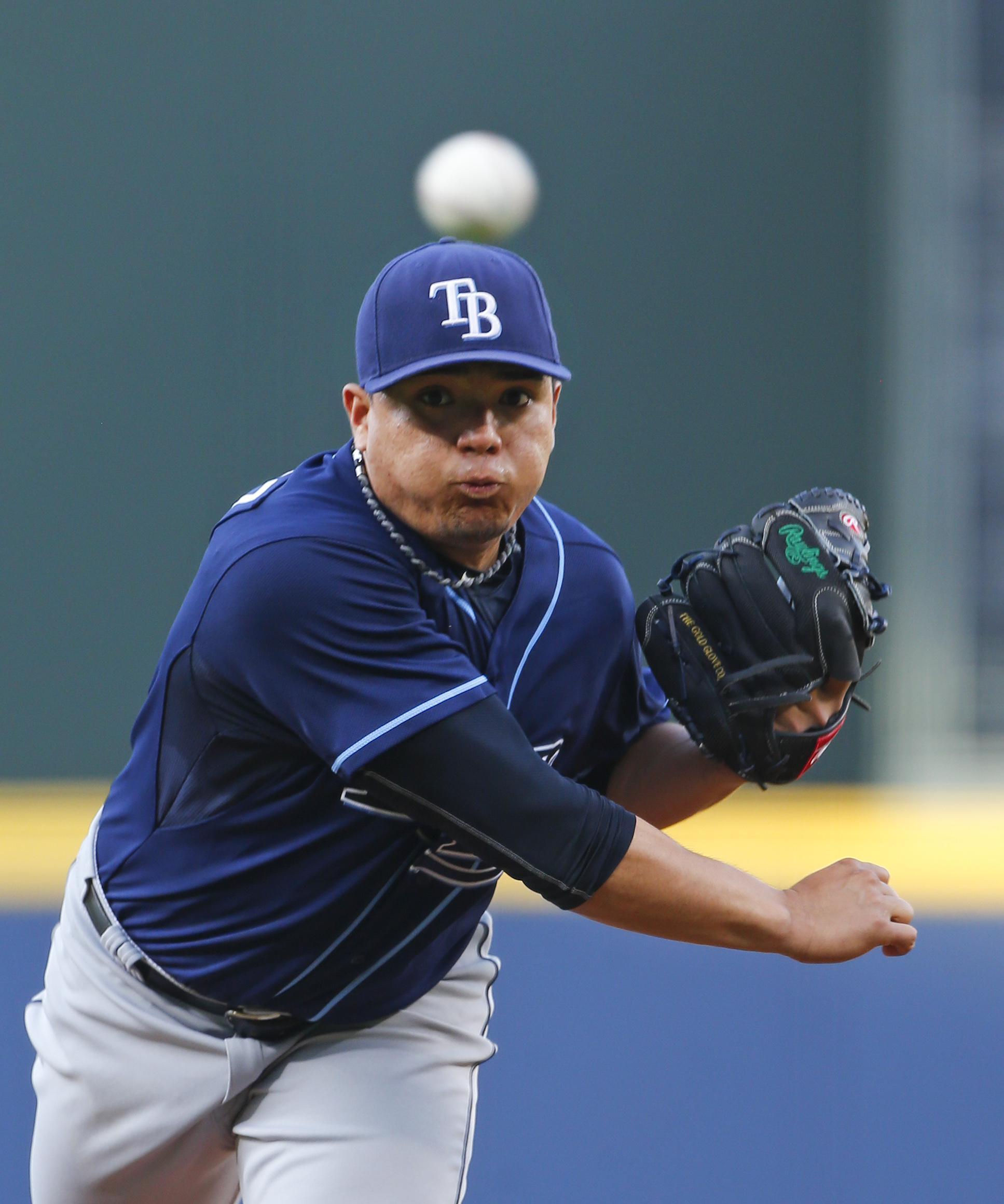 Tampa Bay Rays starting pitcher Erasmo Ramirez (30) works in the first inning of a baseball game  against the Atlanta Braves Tuesday, May 19, 2015, in Atlanta.  (AP Photo/ John Bazemore)
