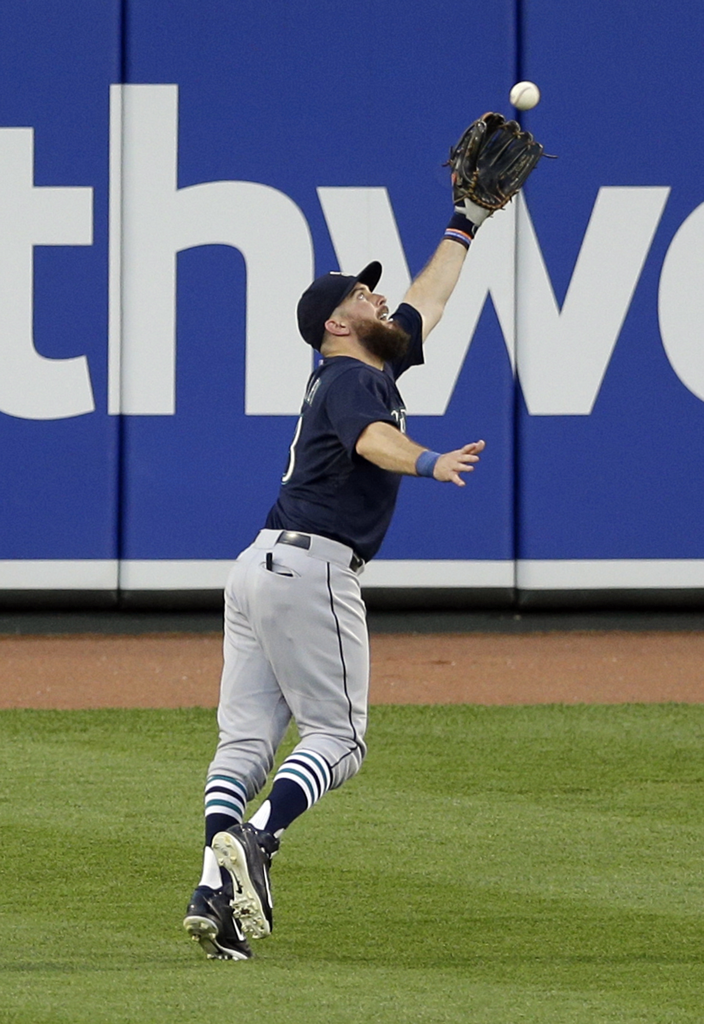 Seattle Mariners center fielder Dustin Ackley catches a fly ball that was hit by Baltimore Orioles' Jimmy Paredes in the third inning of a baseball game, Tuesday, May 19, 2015, in Baltimore. (AP Photo/Patrick Semansky)