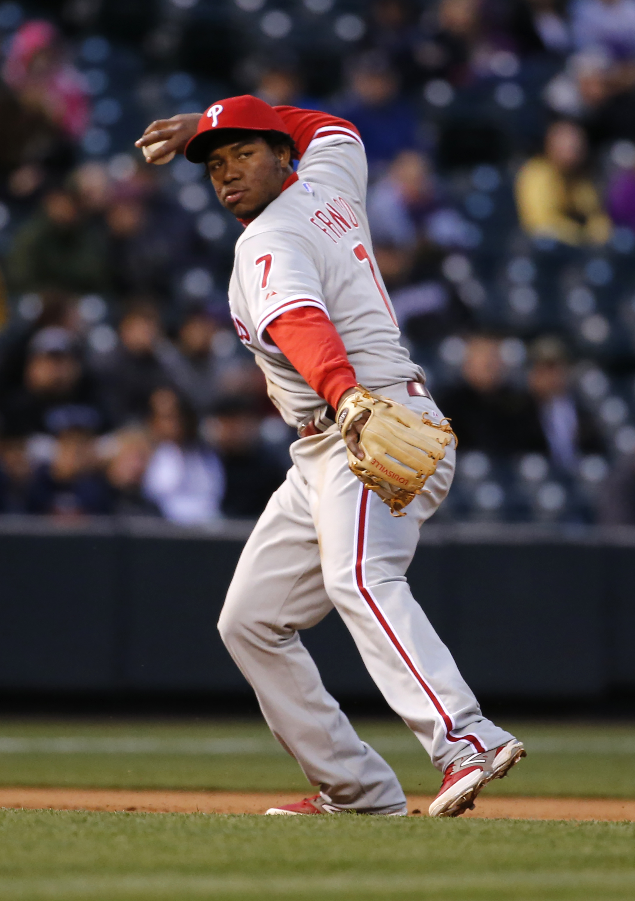 Philadelphia Phillies third baseman Maikel Franco throws out Colorado Rockies' Troy Tulowitzki at first during the third inning of a baseball game Tuesday, May 19, 2015, in Denver. (AP Photo/Jack Dempsey)