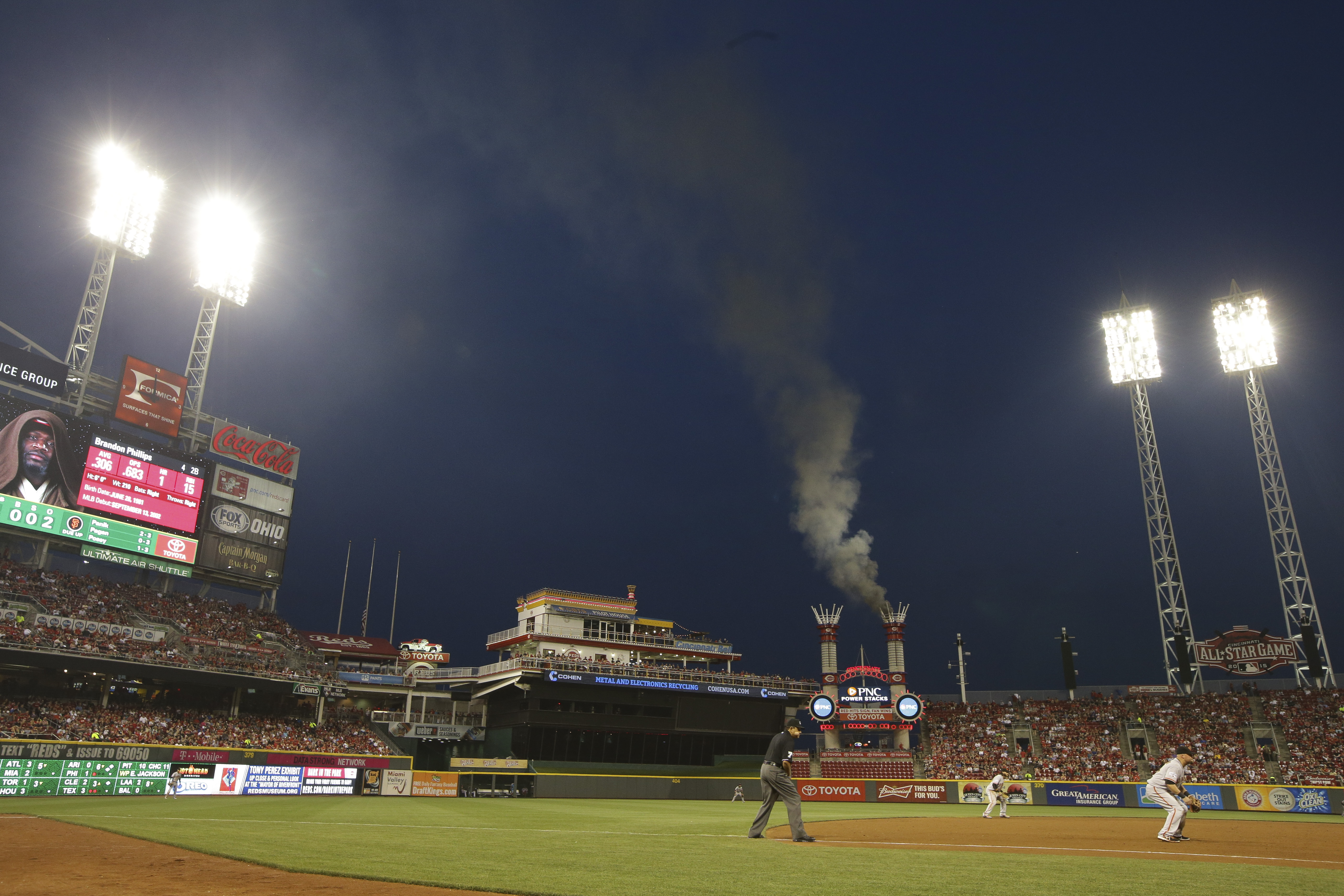 FILE - In this Friday, May 15, 2015, file photo, a fire burns in one of the outfield stacks at Great American Ballpark in the sixth inning of a baseball game between the San Francisco Giants and the Cincinnati Reds, in Cincinnati. Reds officials say the f