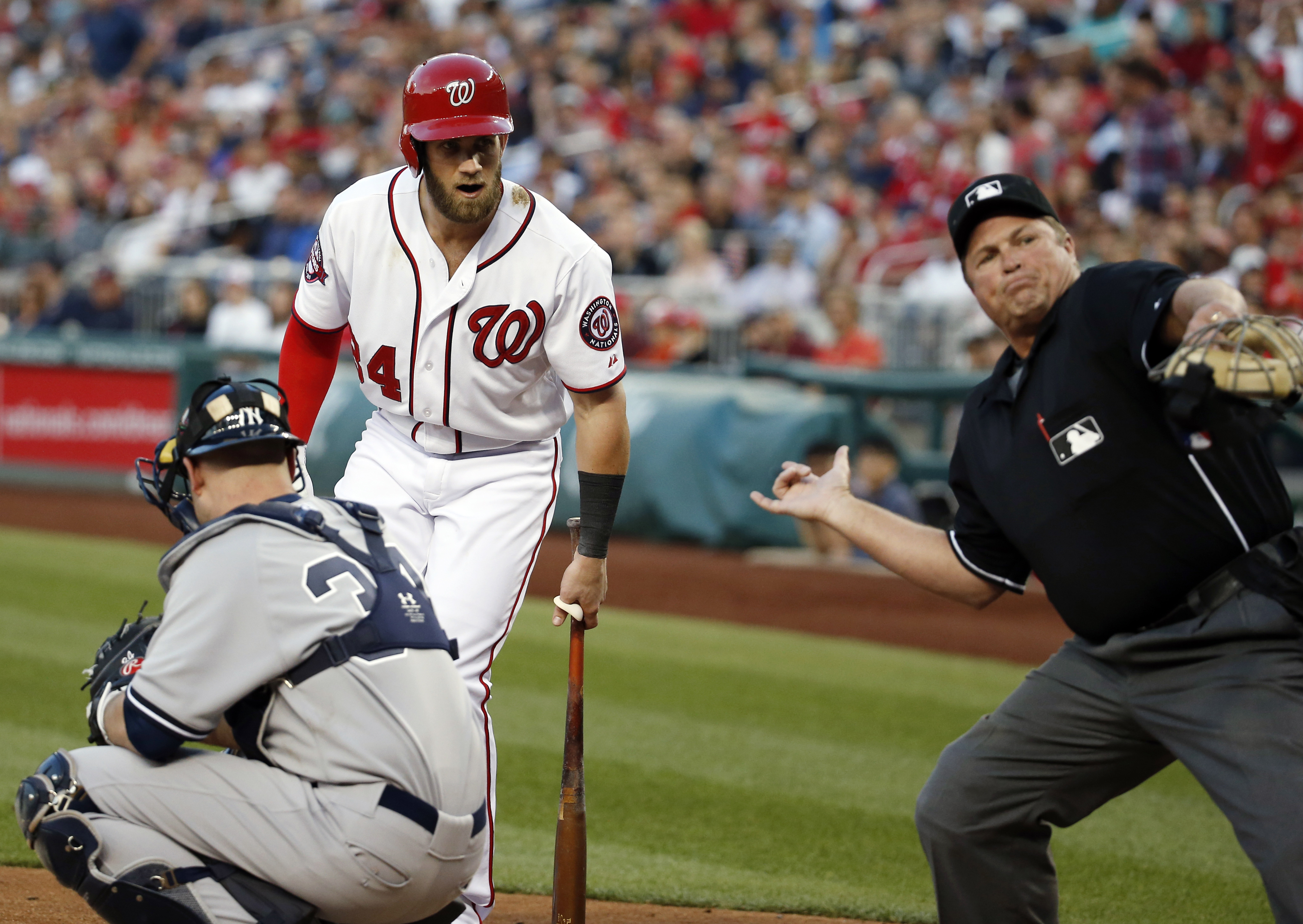 Washington Nationals' Bryce Harper (34) is ejected by home plate umpire Marvin Hudson during the third inning of a  baseball game against the New York Yankees at Nationals Park, Wednesday, May 20, 2015, in Washington. Nationals manager Matt Williams was l