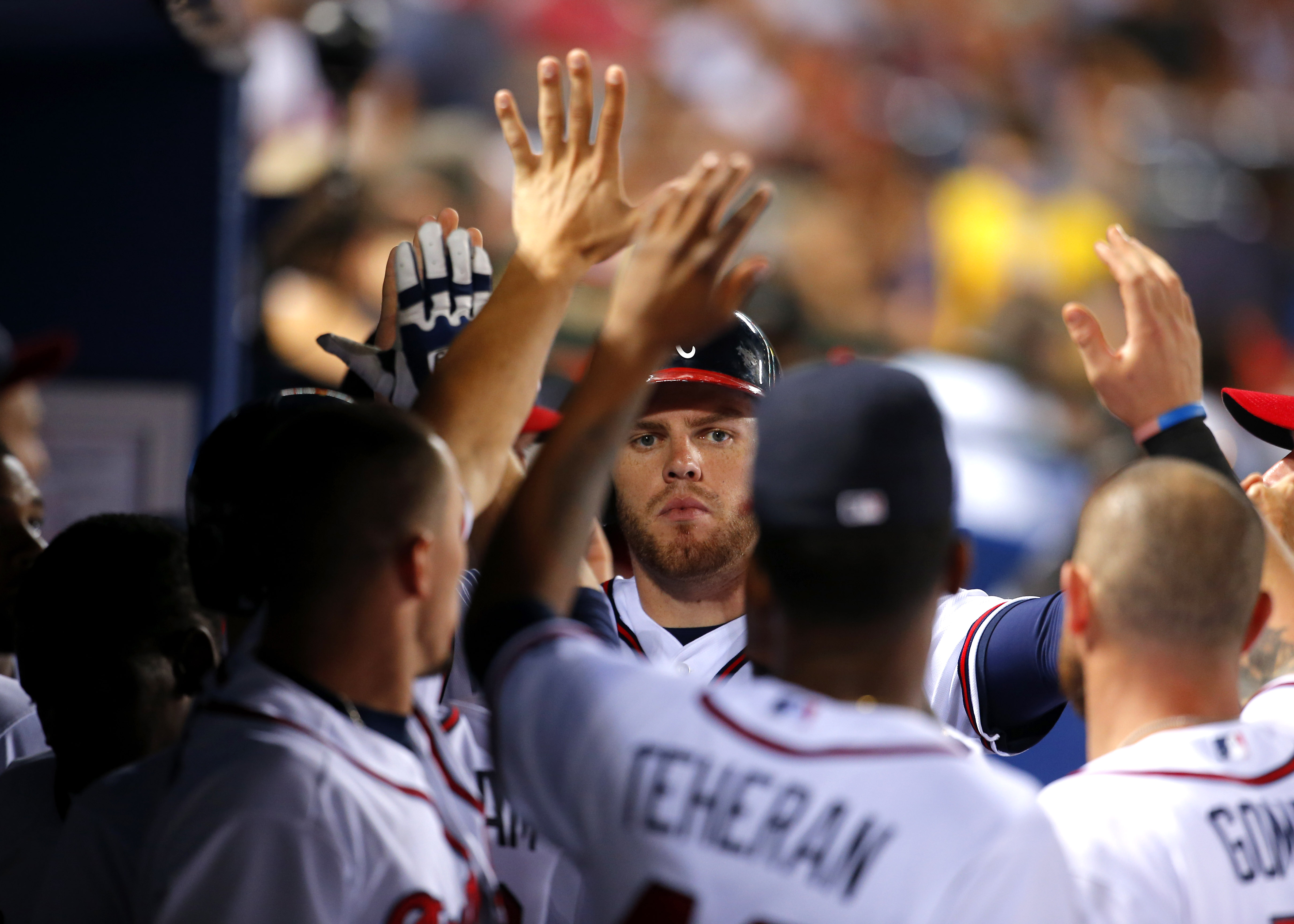 Atlanta Braves Freddie Freeman celebrates with teammates after scoring on a ground out by Todd Cunningham in the sixth inning of a baseball game against the Tampa Bay Rays Wednesday, May 20, 2015, in Atlanta. (AP Photo/Todd Kirkland)