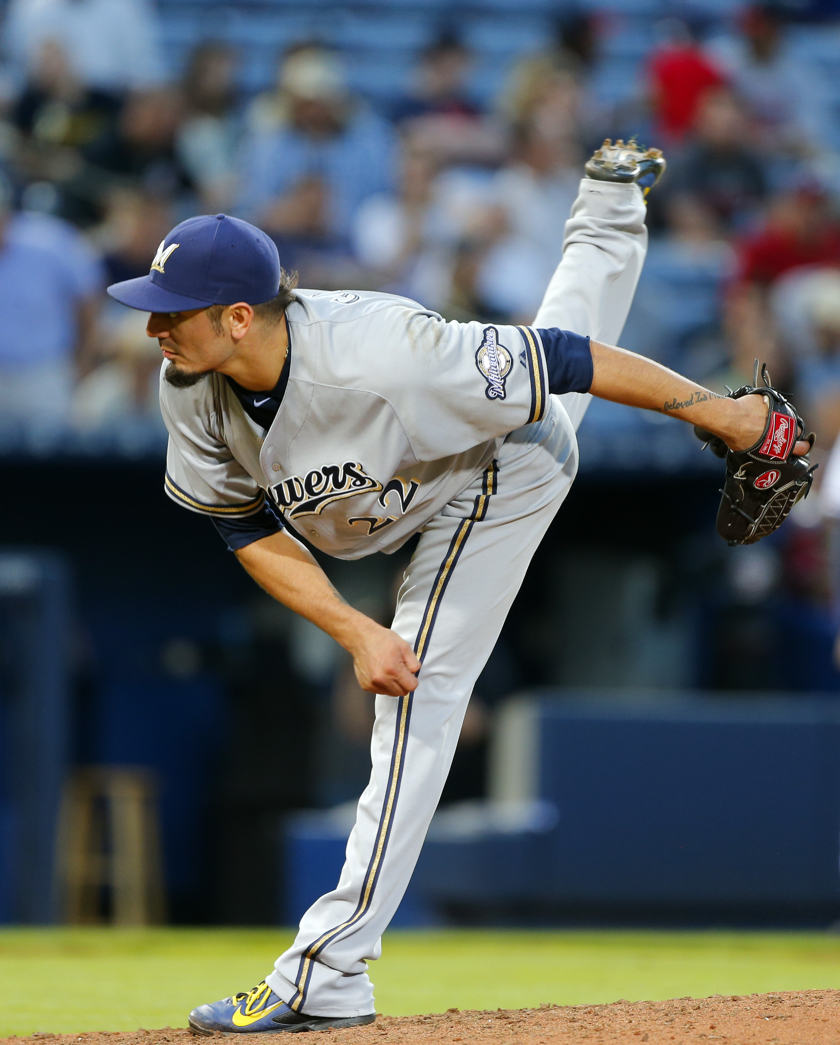 Milwaukee Brewers starting pitcher Matt Garza follows through on a pitch during the fifth inning of a baseball game against the Atlanta Braves on Thursday, May 21, 2015, in Atlanta. (AP Photo/John Bazemore)