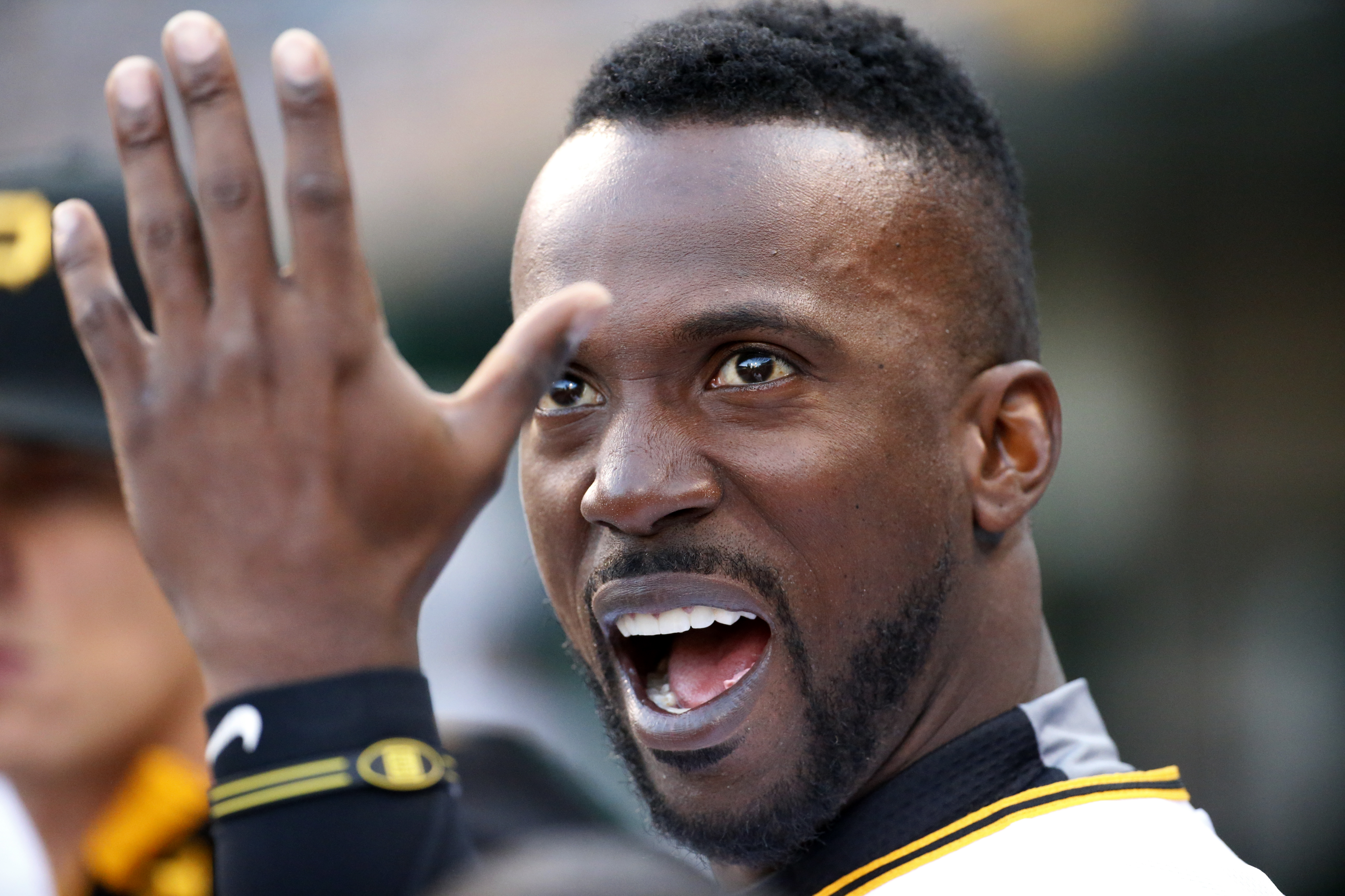 Pittsburgh Pirates' Andrew McCutchen reacts while watching teammate Gregory Polanco steal second on the scoreboard replay during the second inning of a baseball game against the New York Mets in Pittsburgh, Friday, May 22, 2015. (AP Photo/Gene J. Puskar)