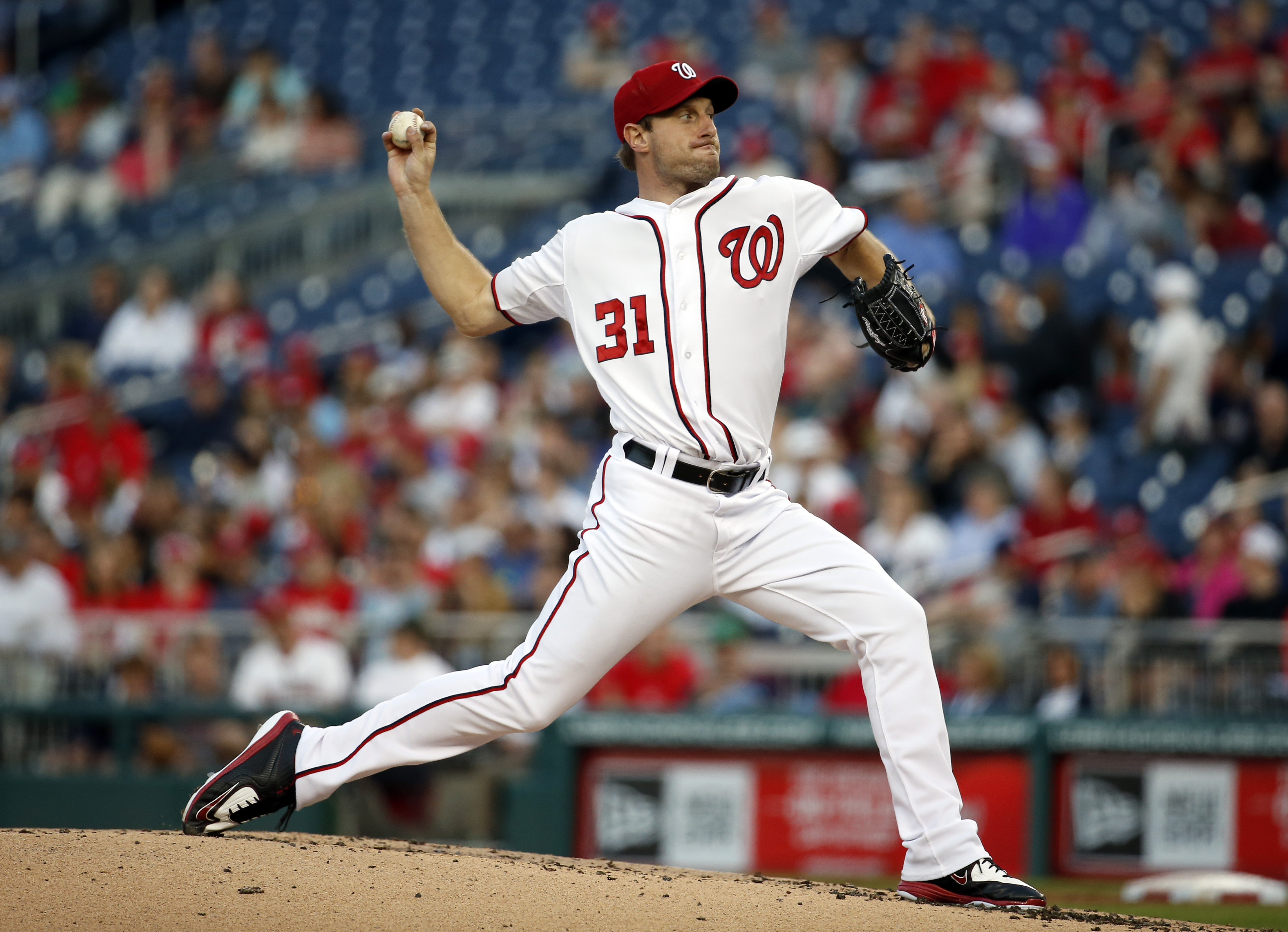 Washington Nationals starting pitcher Max Scherzer (31) throws during the third inning of a baseball game against the Philadelphia Phillies at Nationals Park, Friday, May 22, 2015, in Washington. (AP Photo/Alex Brandon)