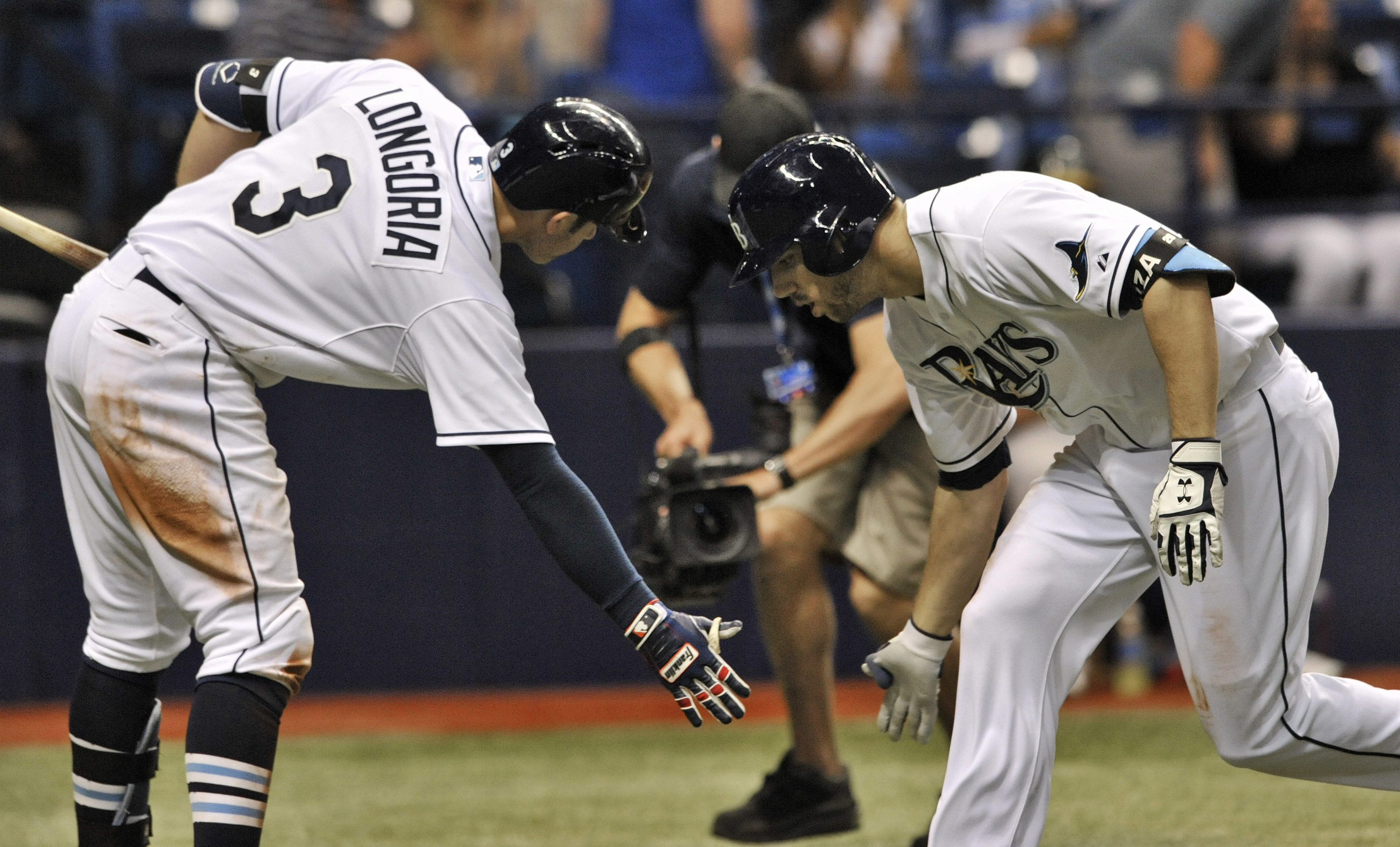 Tampa Bay Rays' on-deck batter Evan Longoria (3) congratulates Steven Souza Jr. after his solo home run to left field off Oakland Athletics reliever Evan Scribner during the seventh inning of a baseball game Friday, May 22, 2015, in St. Petersburg, Fla. (