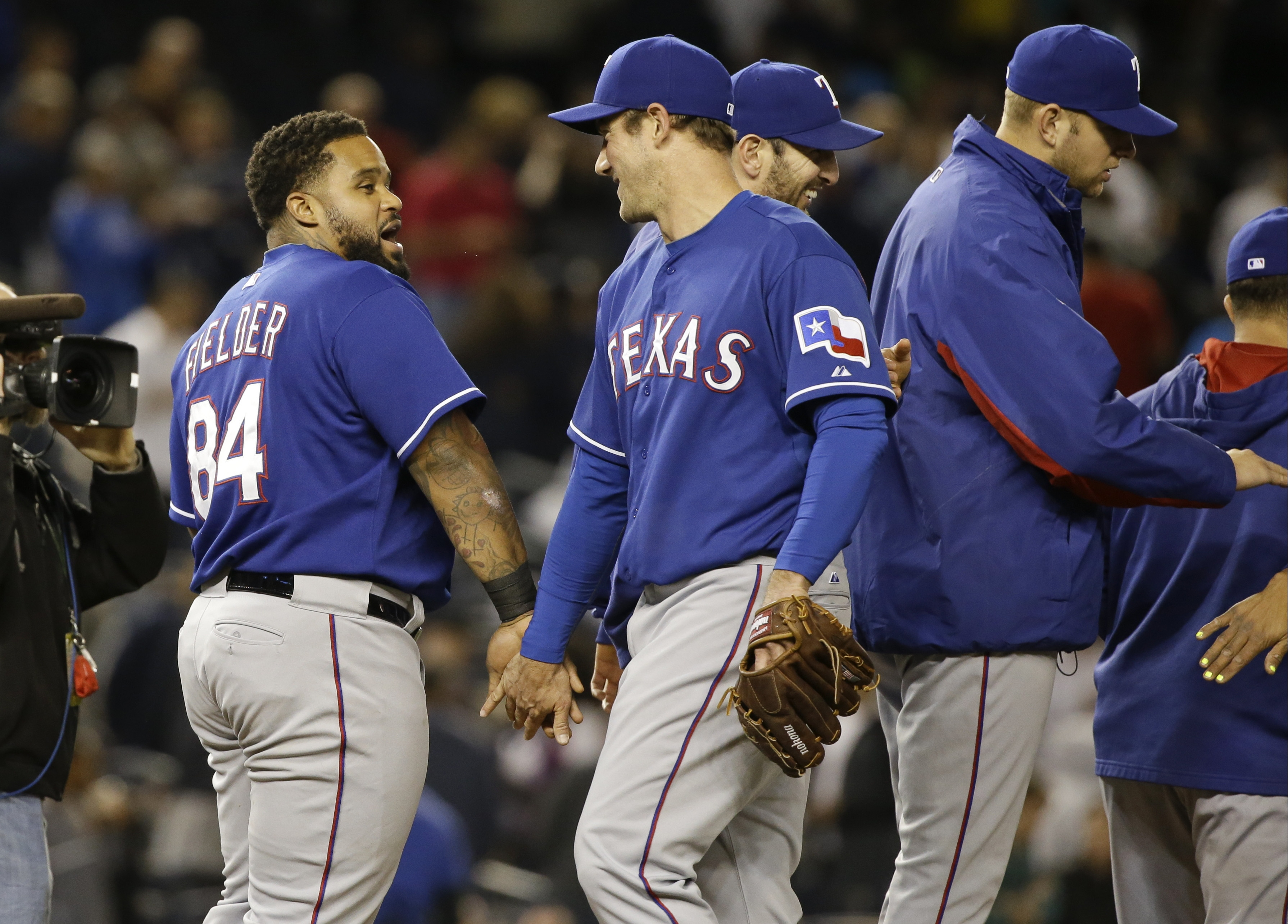 Texas Rangers' Prince Fielder (84) celebrates with teammates after a baseball game against the New York Yankees on Friday, May 22, 2015, in New York. The Rangers won 10-9. (AP Photo/Frank Franklin II)