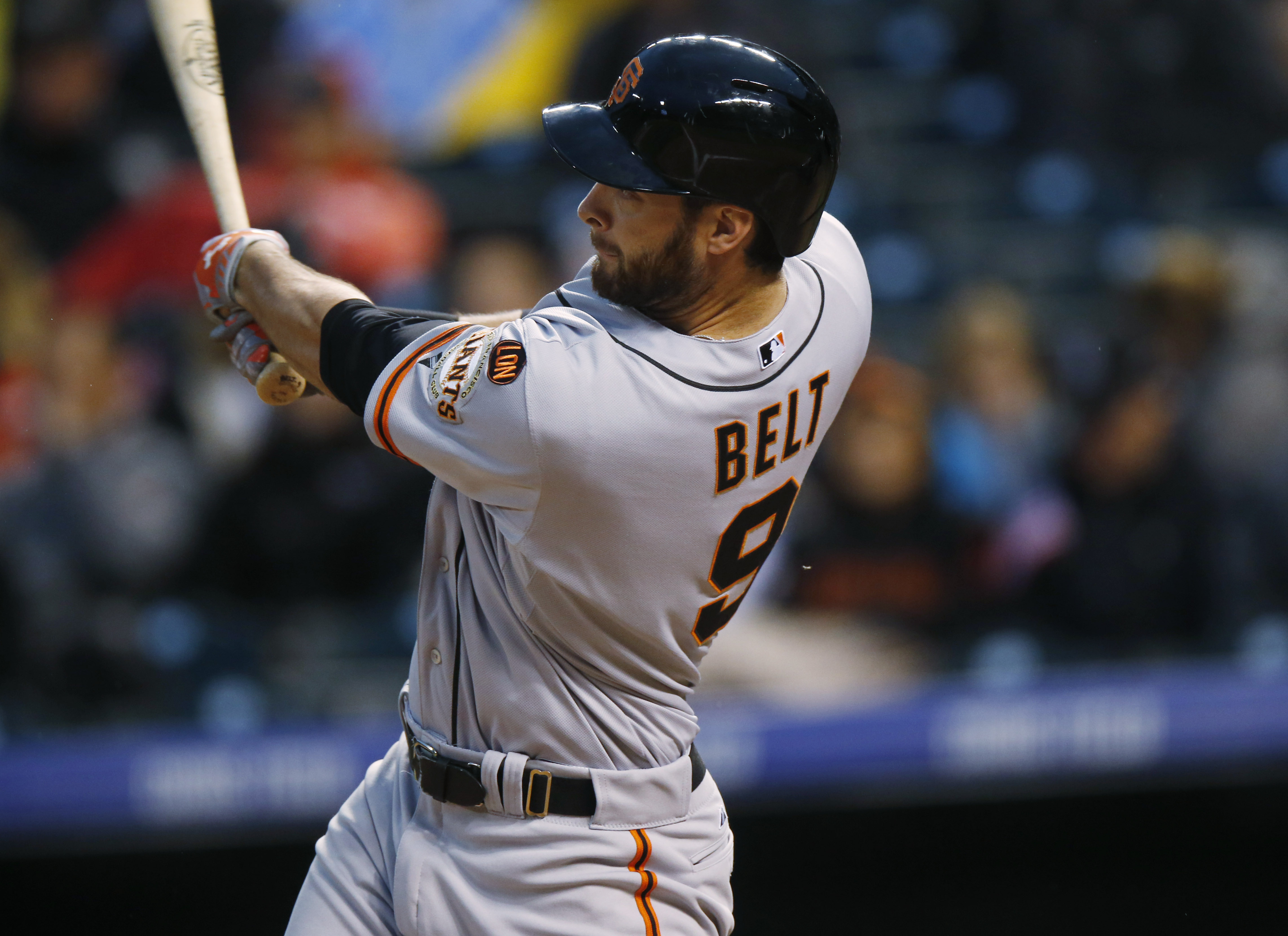 San Francisco Giants' Brandon Belt follows the flight of his two-run home run off Colorado Rockies starting pitcher Kyle Kendrick in the sixth inning of a baseball game Friday, May 22, 2015, in Denver. (AP Photo/David Zalubowski)