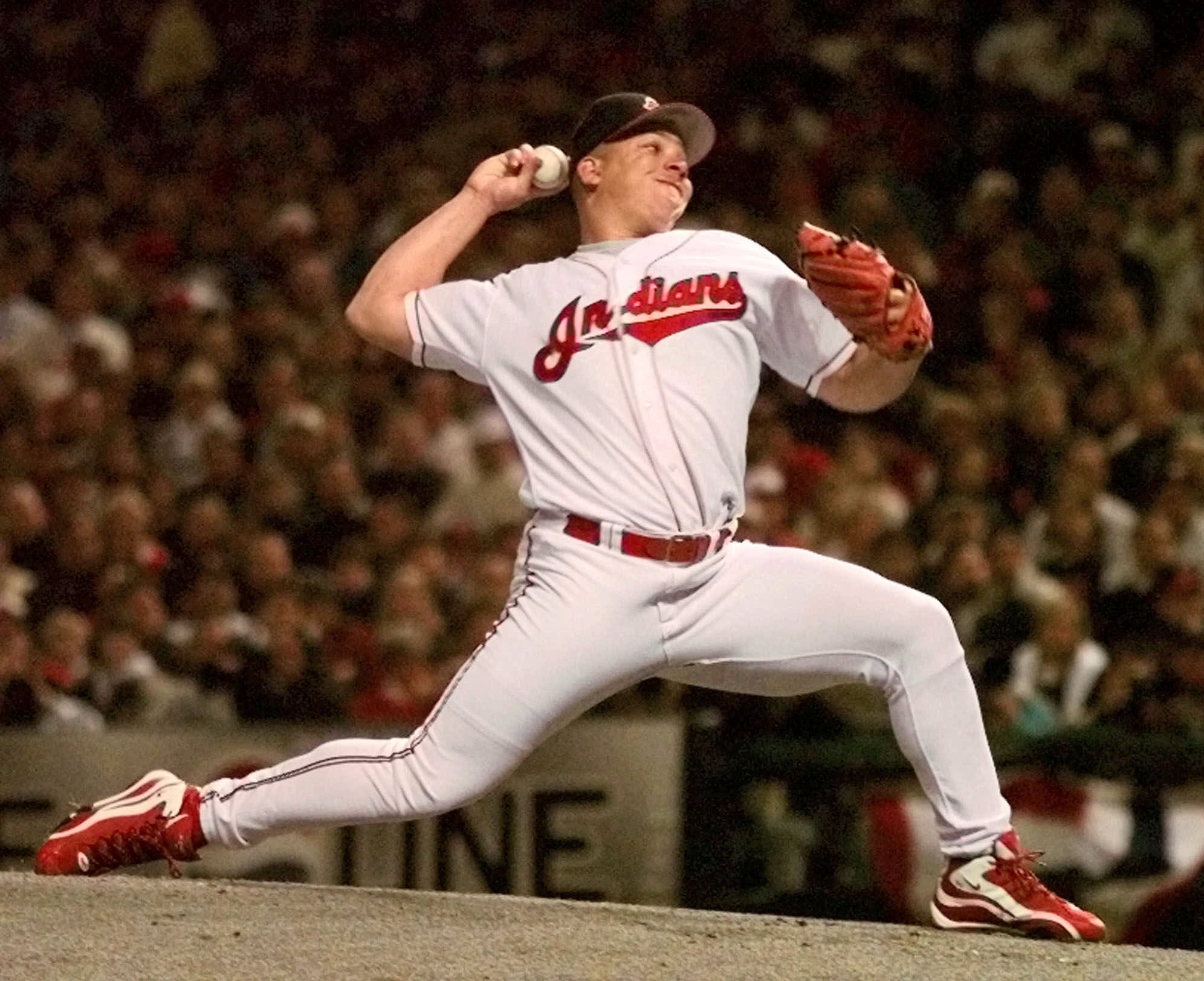 FILE - In this Oct. 9, 1998, file photo, Cleveland Indians pitcher Bartolo Colon delivers a pitch against the New York Yankees in the first inning of Game 3 of the American League championship series in Cleveland. Colon turns 42 on Sunday, and in his 18th