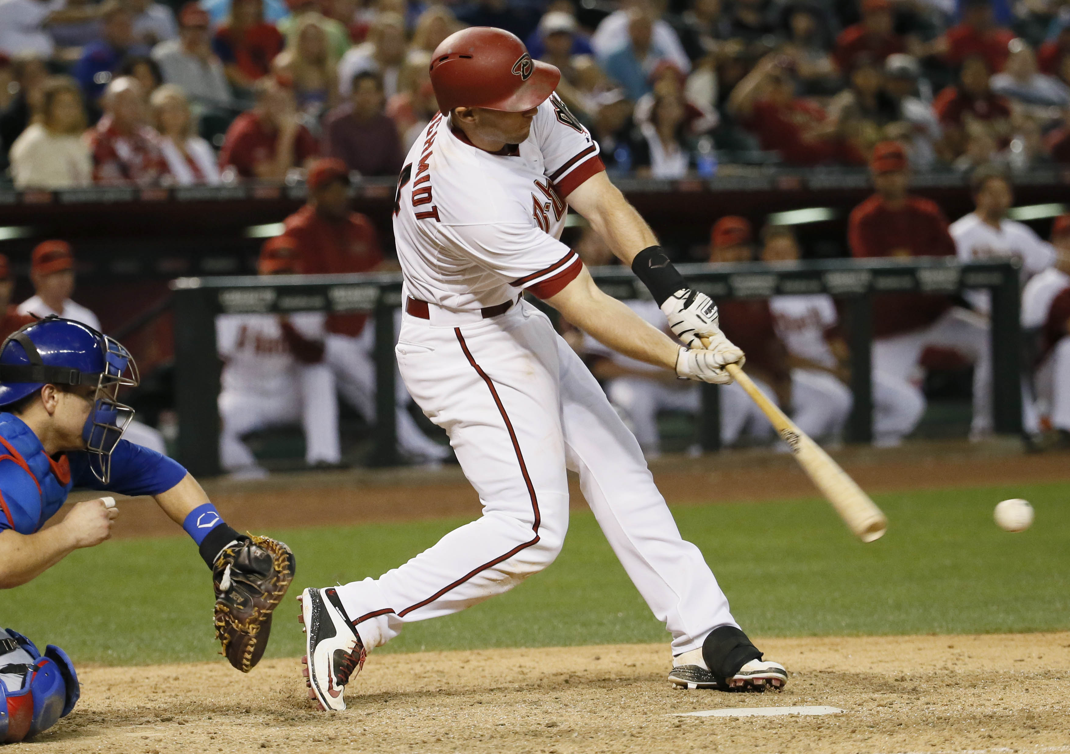 Arizona Diamondbacks Paul Goldschmidt swings on a two-run home run against the Chicago Cubs during the 10th inning of a baseball game, Friday, May 22, 2015, in Phoenix. (AP Photo/Matt York)
