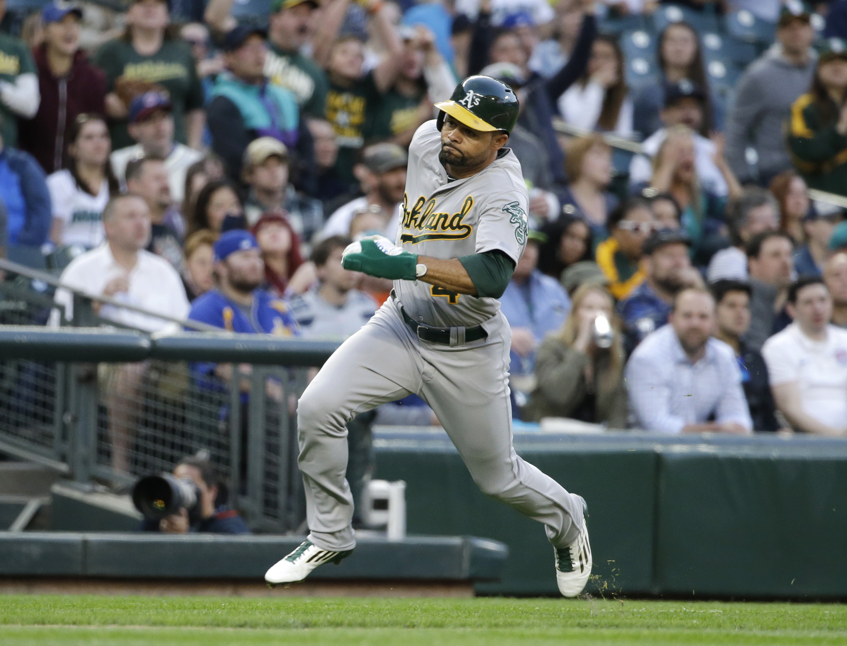 Oakland Athletics' Coco Crisp in action against the Seattle Mariners in a baseball game Friday, May 8, 2015, in Seattle. (AP Photo/Elaine Thompson)