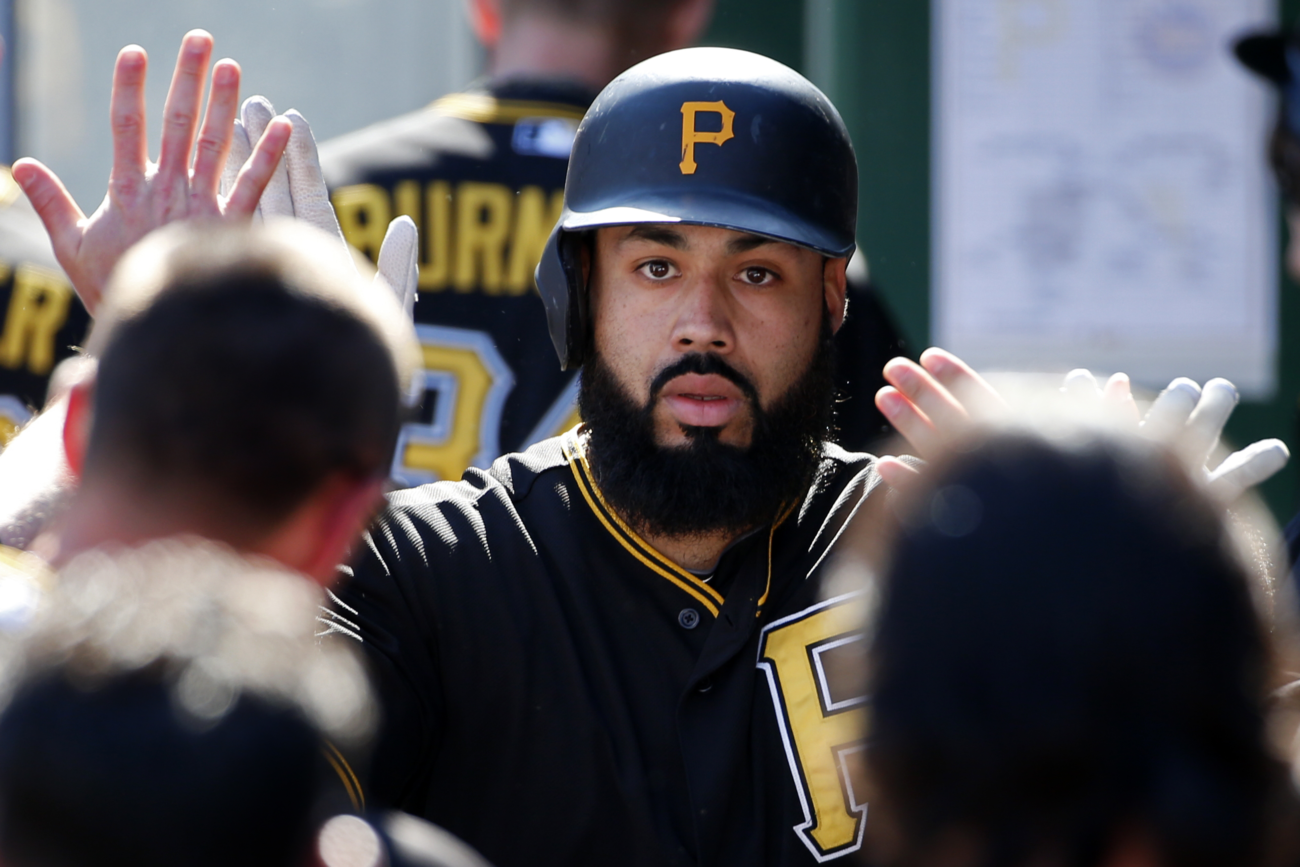Pittsburgh Pirates' Pedro Alvarez celebrates with teammates in the dugout after hitting a solo home run off New York Mets starting pitcher Matt Harvey in the second inning of a baseball game in Pittsburgh, Saturday, May 23, 2015. (AP Photo/Gene J. Puskar)