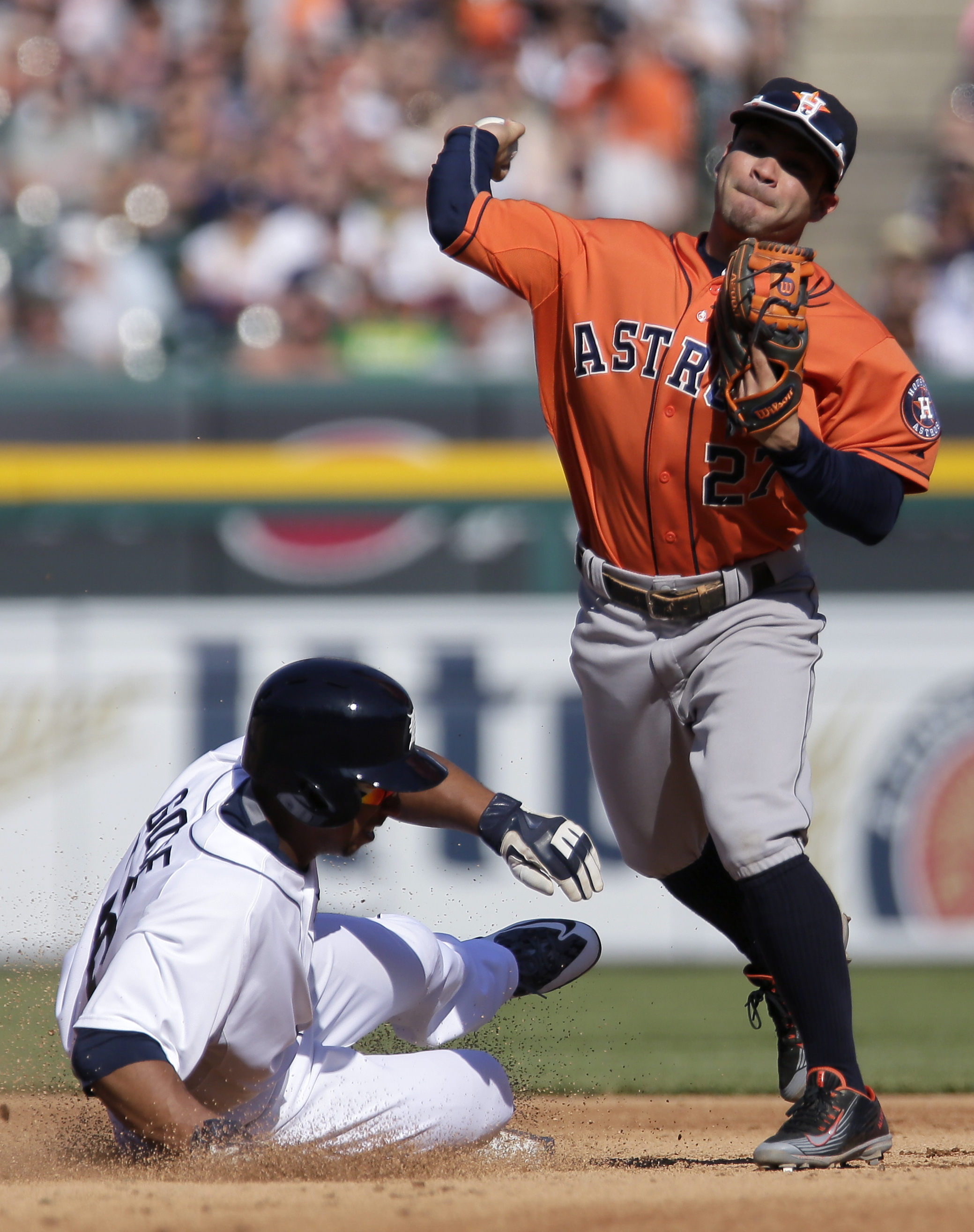 Houston Astros second baseman Jose Altuve (27) gets the force out on Detroit Tigers' Anthony Gose for the second out of a triple play during the fifth inning of a baseball game Saturday, May 23, 2015, in Detroit. Detroit's Ian Kinsler hit to Houston third