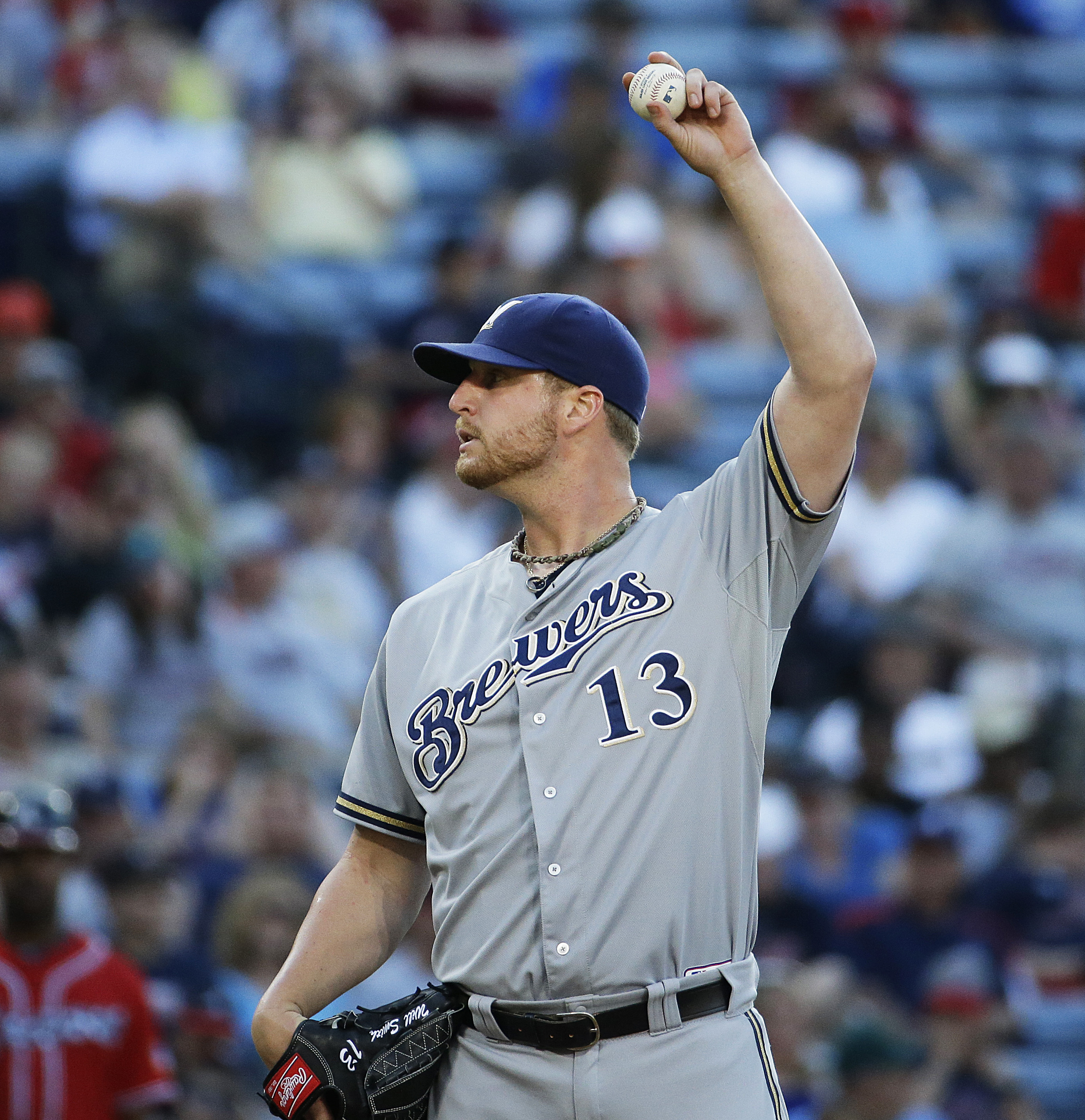 Milwaukee Brewers relief pitcher Will Smith prepares to throw in the eighth inning of a baseball game against the Atlanta Braves Saturday, May 23, 2015, in Atlanta. (AP Photo/David Goldman)