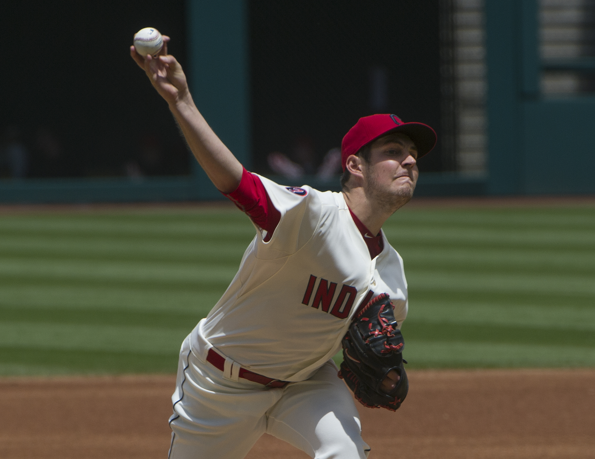 Cleveland indians' Trevor Bauer delivers to Cincinnati Reds' Brandon Phillips during the first inning of a baseball game in Cleveland, Sunday, May 24, 2015. (AP Photo/Phil Long)