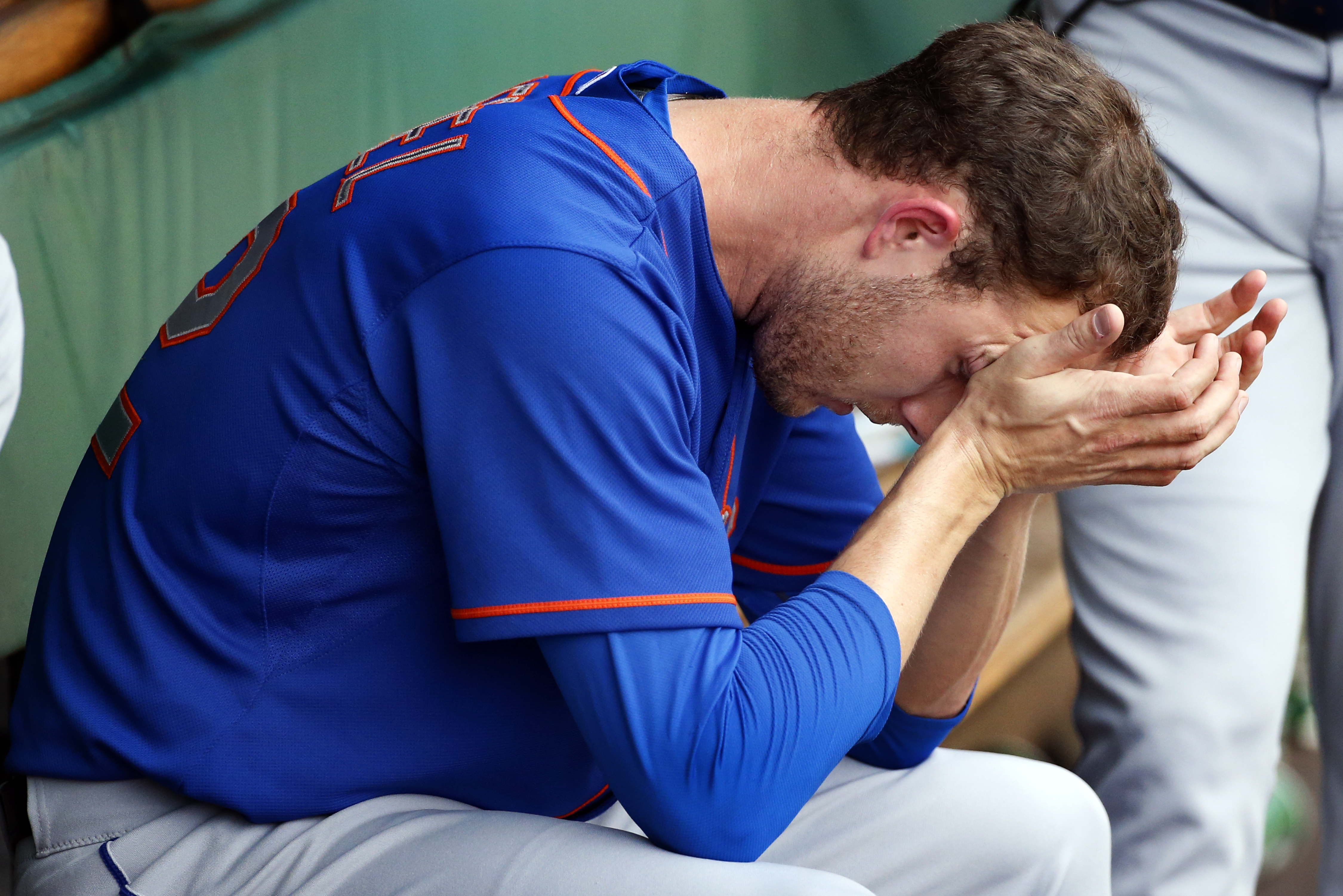 New York Mets relief pitcher Erik Goeddel sits in the dugout after giving up a three-run home run to Pittsburgh Pirates' Starling Marte in the sixth inning of a baseball game in Pittsburgh, Sunday, May 24, 2015. (AP Photo/Gene J. Puskar)