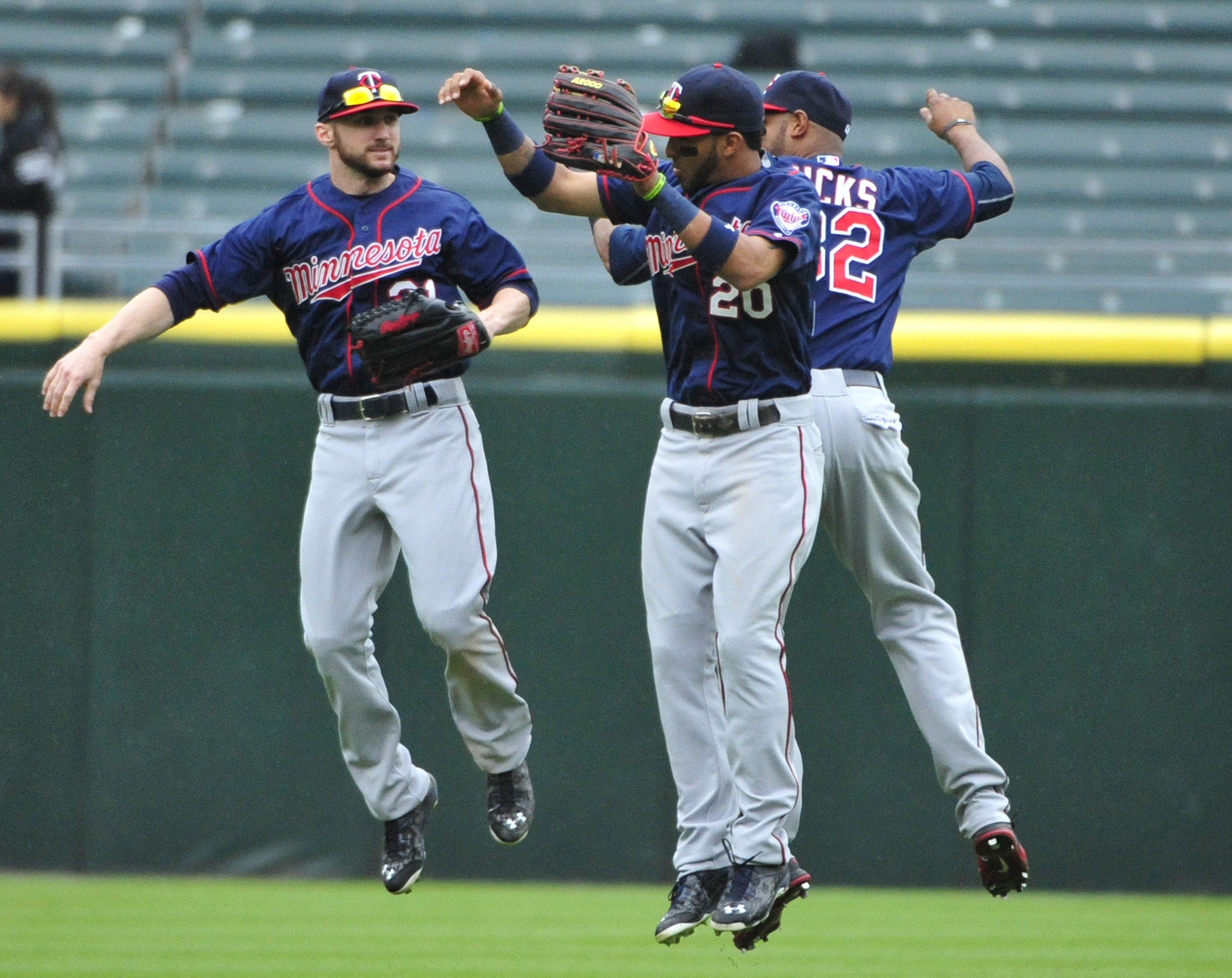 Minnesota Twins' Shane Robinson, left, Eddie Rosario, center, and Aaron Hicks, right, celebrate their 8-1 win in a baseball game against the Chicago White Sox, Sunday, May 24, 2015, in Chicago. (AP Photo/David Banks)
