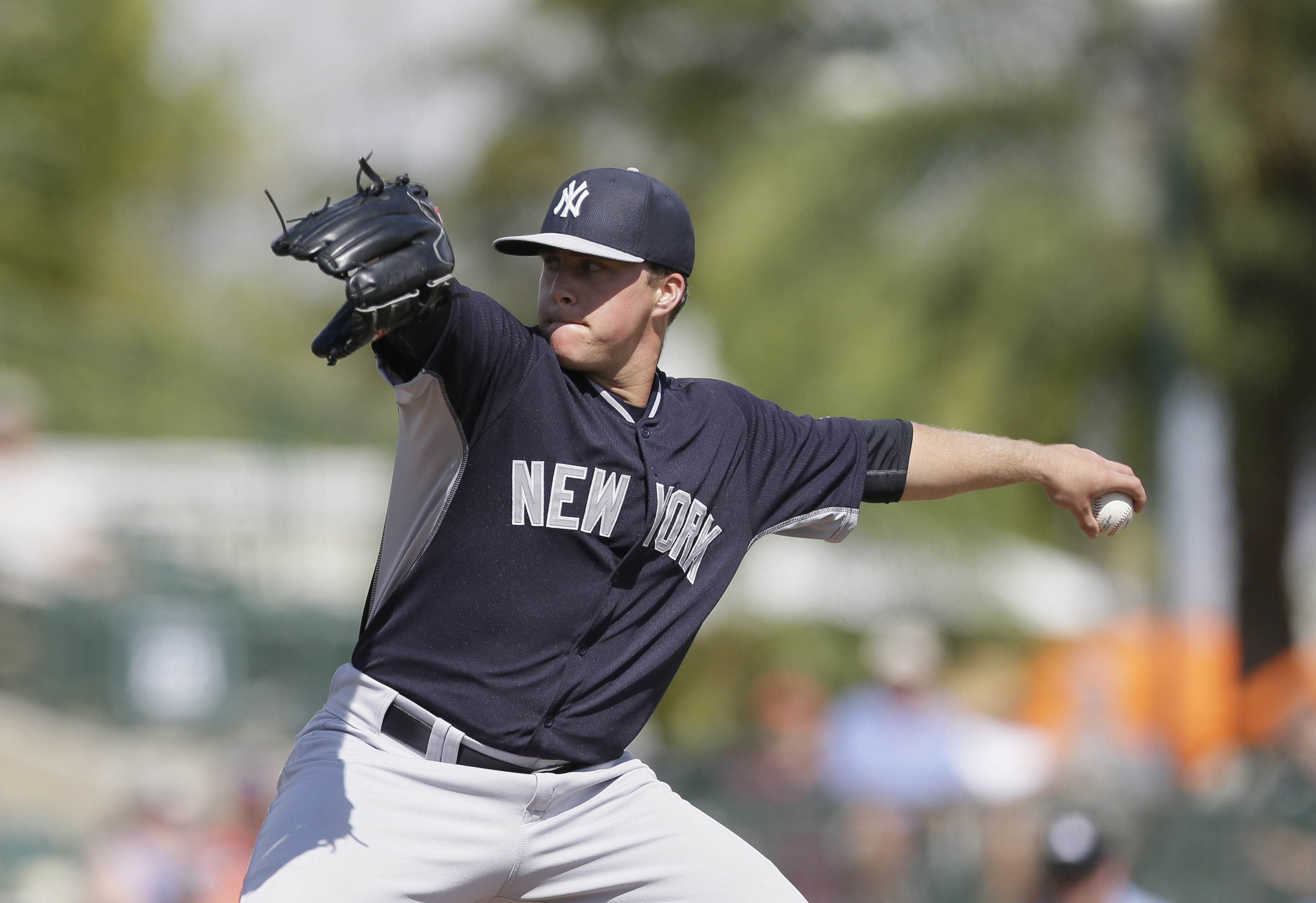 FILE - In this March 10, 2015 file photo, New York Yankees relief pitcher Jacob Lindgren throws during the eighth inning of a spring training exhibition baseball game against the Baltimore Orioles in Sarasota, Fla. Selected in the second round with the 55