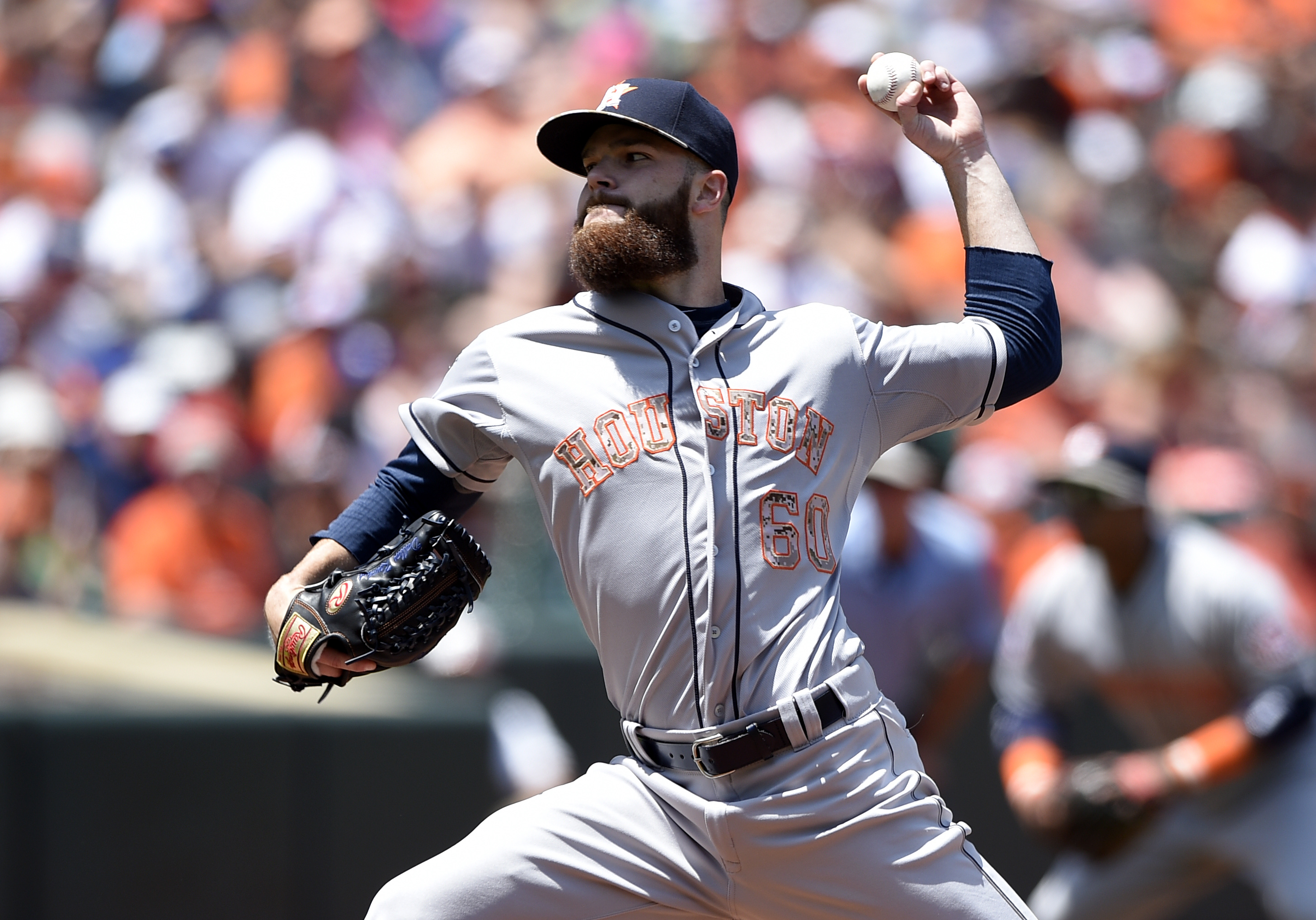 CORRECTS TO FIRST INNING, NOT SECOND AS ORIGINALLY SENT - Houston Astros starting pitcher Dallas Keuchel delivers a pitch against the Baltimore Orioles during the first inning of a baseball game, Monday, May 25, 2015, in Baltimore. (AP Photo/Nick Wass)