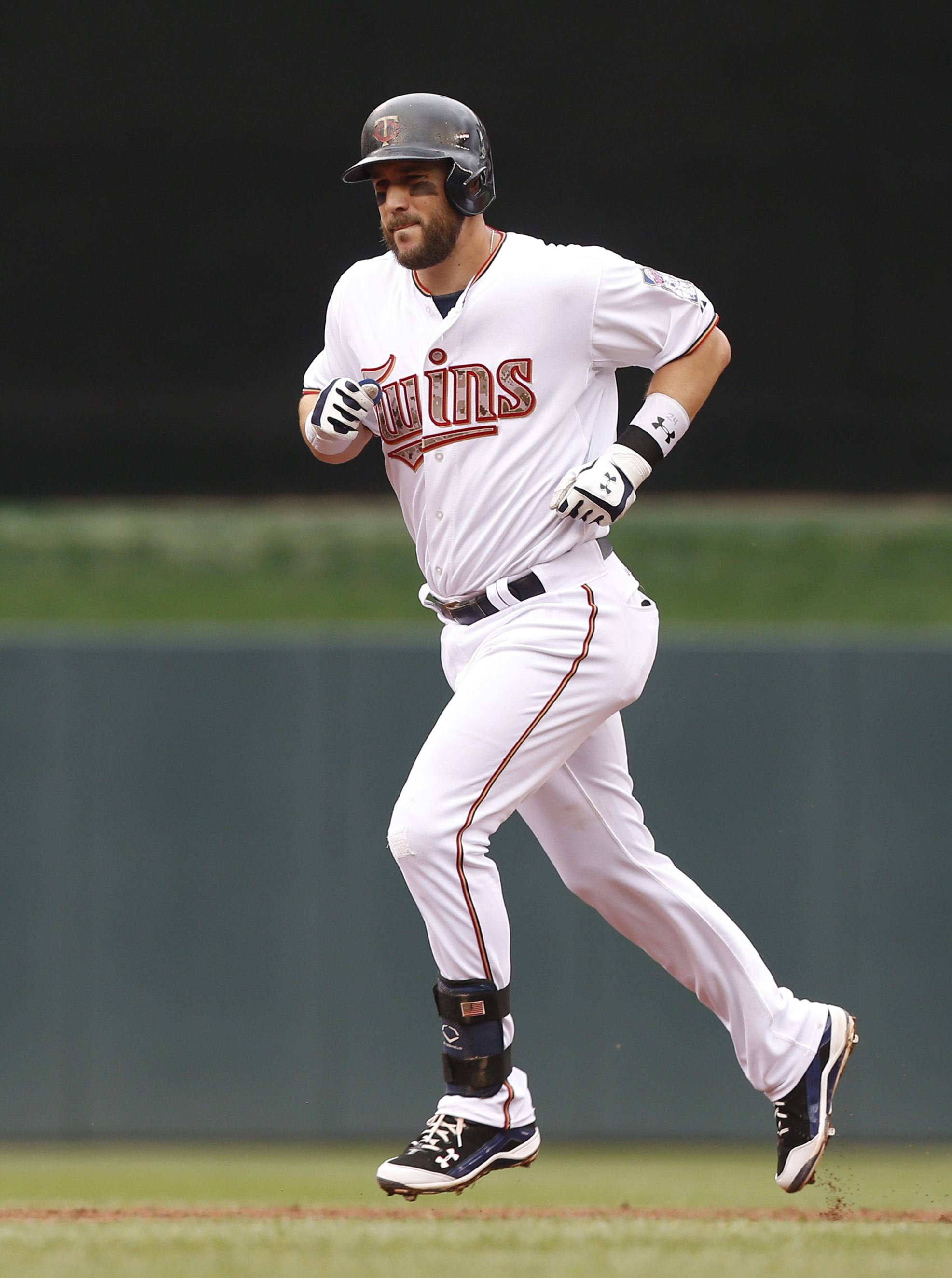 Minnesota Twins' Trevor Plouffe rounds the bases on a three-run home run off Boston Red Sox pitcher Joe Kelly in the second inning of a baseball game, Monday, May 25, 2015, in Minneapolis. (AP Photo/Jim Mone)