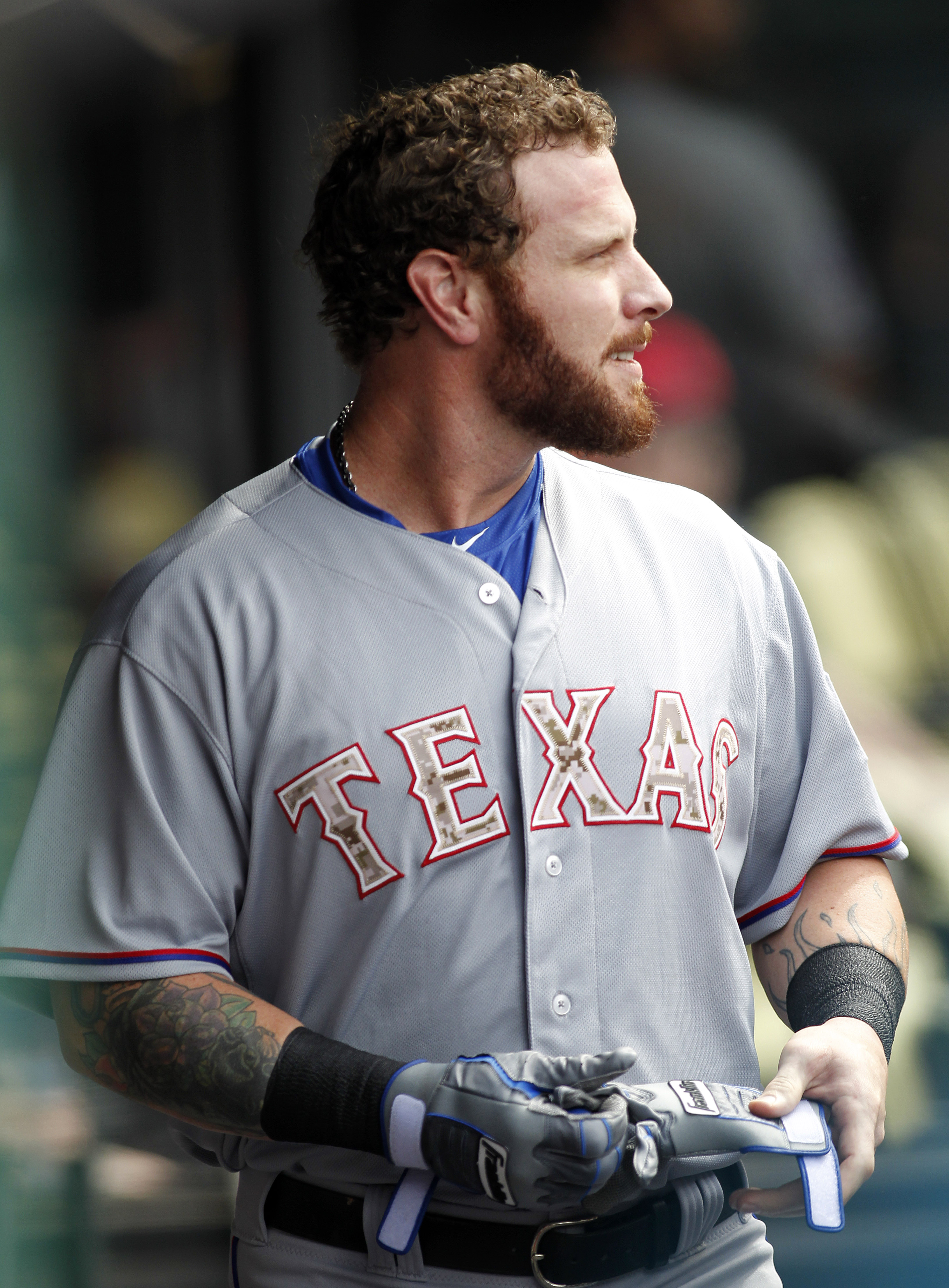Texas Rangers Josh Hamilton takes off his gloves after striking out during the first inning of a baseball game against the Cleveland Indians, Monday, May 25, 2015, in Cleveland. (AP Photo/Aaron Josefczyk)