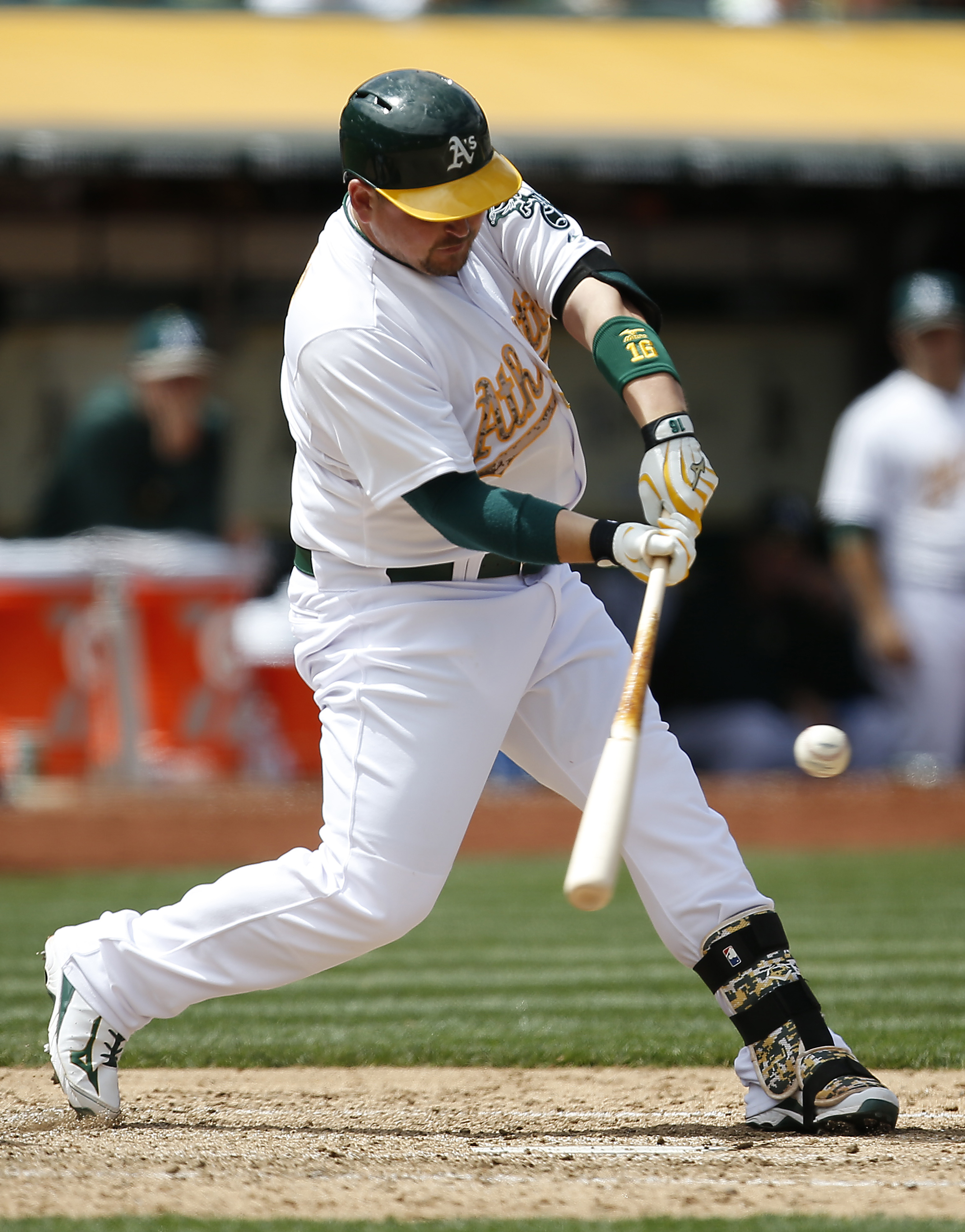 Oakland Athletics' Billy Butler hits a single to drives in a run against the Detroit Tigers during the sixth inning of a baseball game Monday, May 25, 2015, in Oakland, Calif. (AP Photo/Tony Avelar)