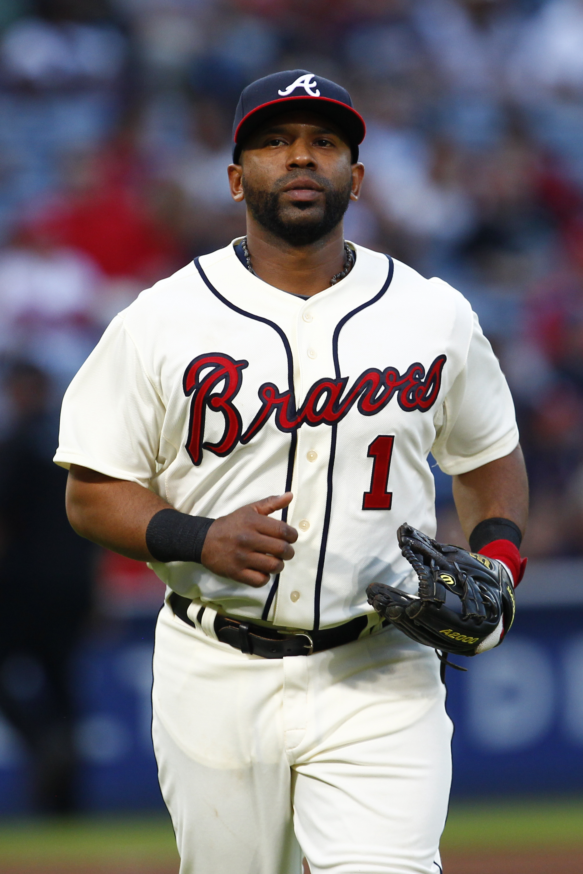 Atlanta Braves' Alberto Callaspo heads back to the dugout during the second inning of a baseball game against the Cincinnati Reds on Saturday, May 2, 2015 in Atlanta. (AP Photo/Kevin Liles)