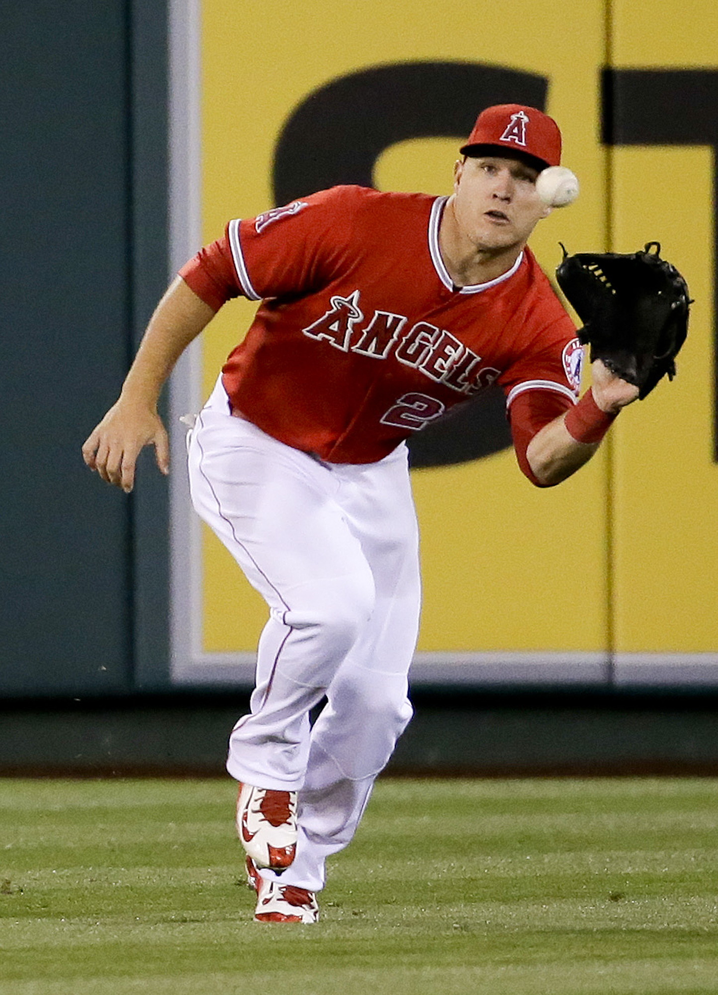 Los Angeles Angels center fielder Mike Trout catches a fly ball hit by San Diego Padres' Alexi Amarista during the fifth inning of a baseball game in Anaheim, Calif., Tuesday, May 26, 2015. (AP Photo/Chris Carlson)