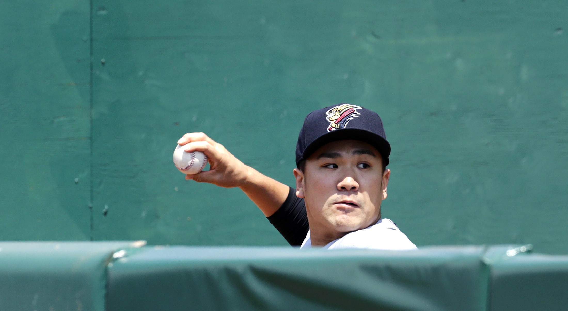 New York Yankees pitcher Masahiro Tanaka warms up in the bullpen prior to a rehab start with the Scranton/Wilkes-Barre RailRaiders against the Pawtucket Red Sox in a minor league baseball game at McCoy Stadium in Pawtucket, Rhode Island, Wednesday, May 27
