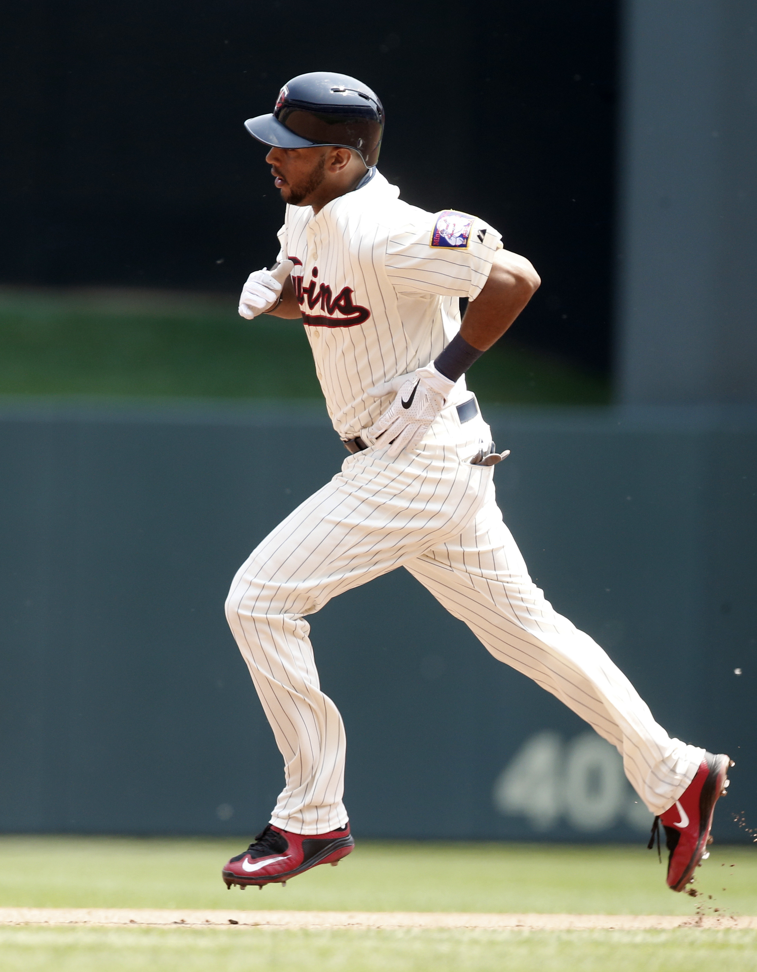 Minnesota Twins' Aaron Hicks rounds the bases with a two-run home run off Boston Red Sox' pitcher Rick Porcello in the fourth inning of a baseball game, Wednesday May 27, 2015, in Minneapolis. (AP Photo/Jim Mone)