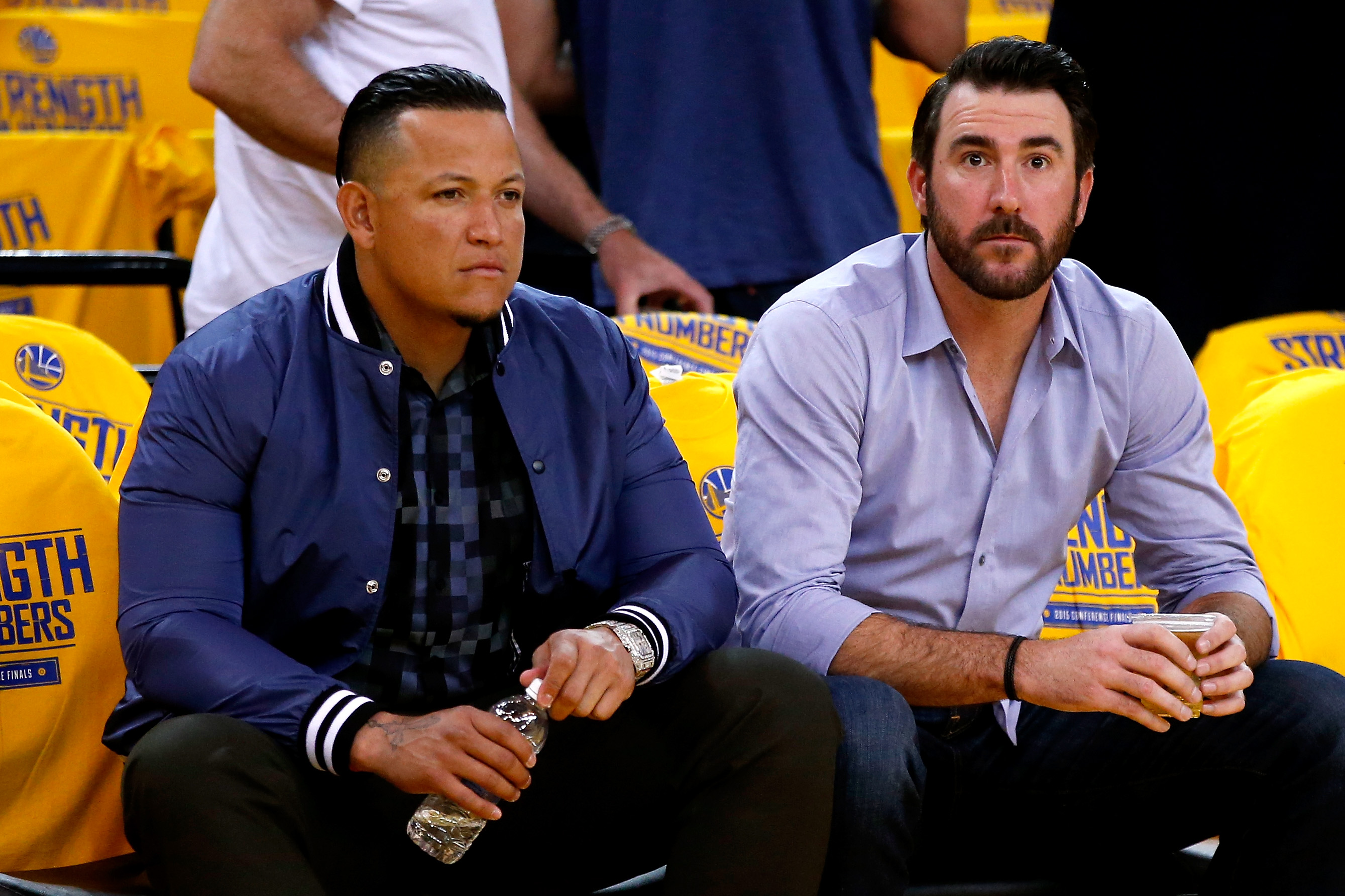 OAKLAND, CA - MAY 27:  (L-R) Miguel Cabrera and Justin Verlander of the Detroit Tigers watch warm ups before game five of the Western Conference Finals of the 2015 NBA Playoffs between the Houston Rockets and the Golden State Warriors at ORACLE Arena on M