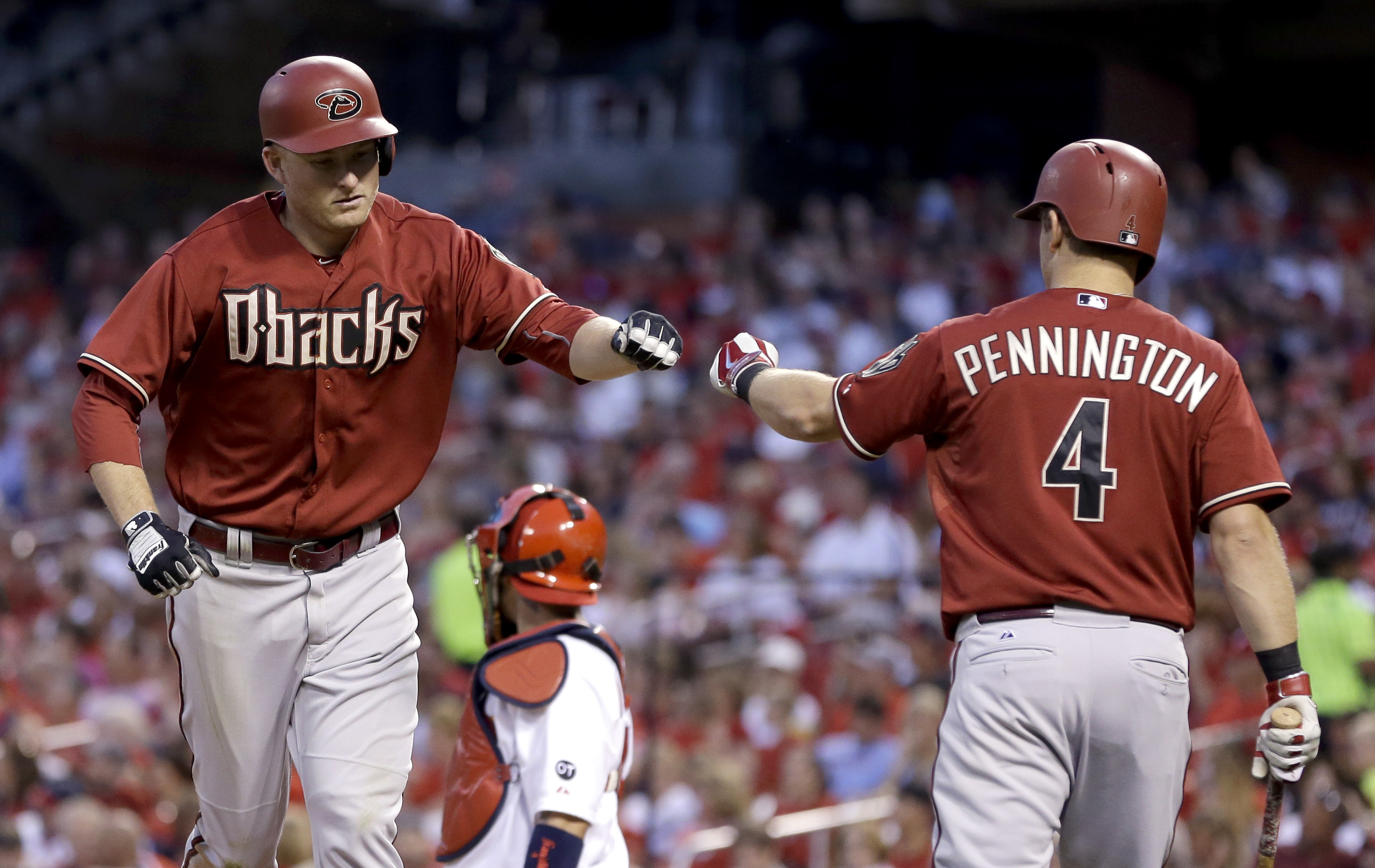Arizona Diamondbacks' Mark Trumbo, left, is congratulated by teammate Cliff Pennington after hitting a solo home run during the fourth inning of a baseball game against the St. Louis Cardinals Wednesday, May 27, 2015, in St. Louis. (AP Photo/Jeff Roberson