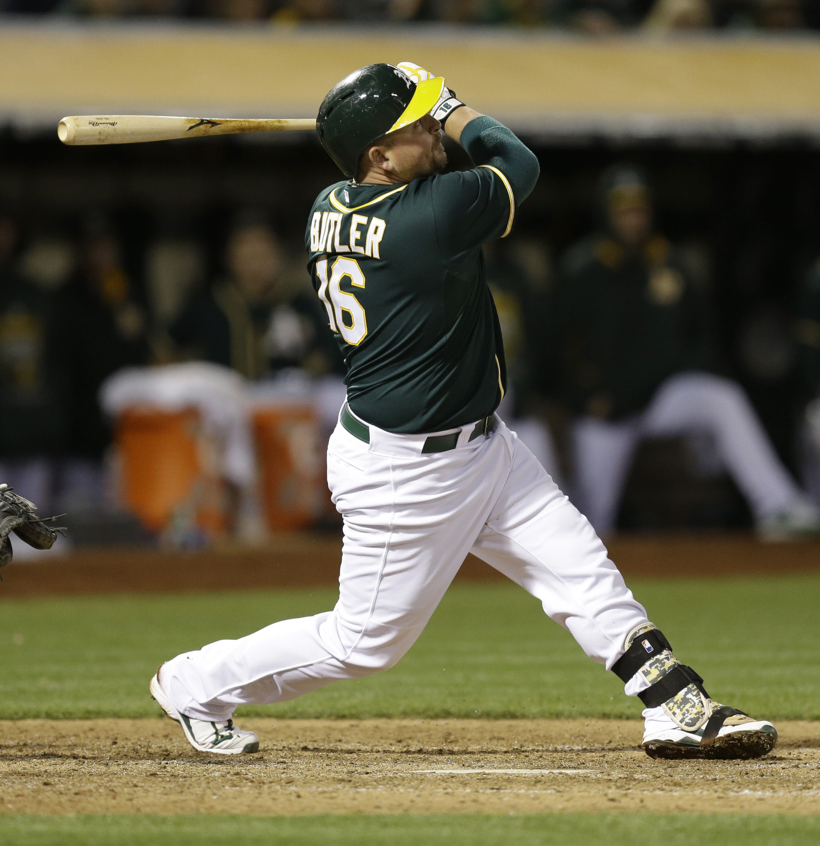 Oakland Athletics' Billy Butler swings for an RBI sacrifice fly off New York Yankees' David Carpenter during the seventh inning of a baseball game Thursday, May 28, 2015, in Oakland, Calif. (AP Photo/Ben Margot)