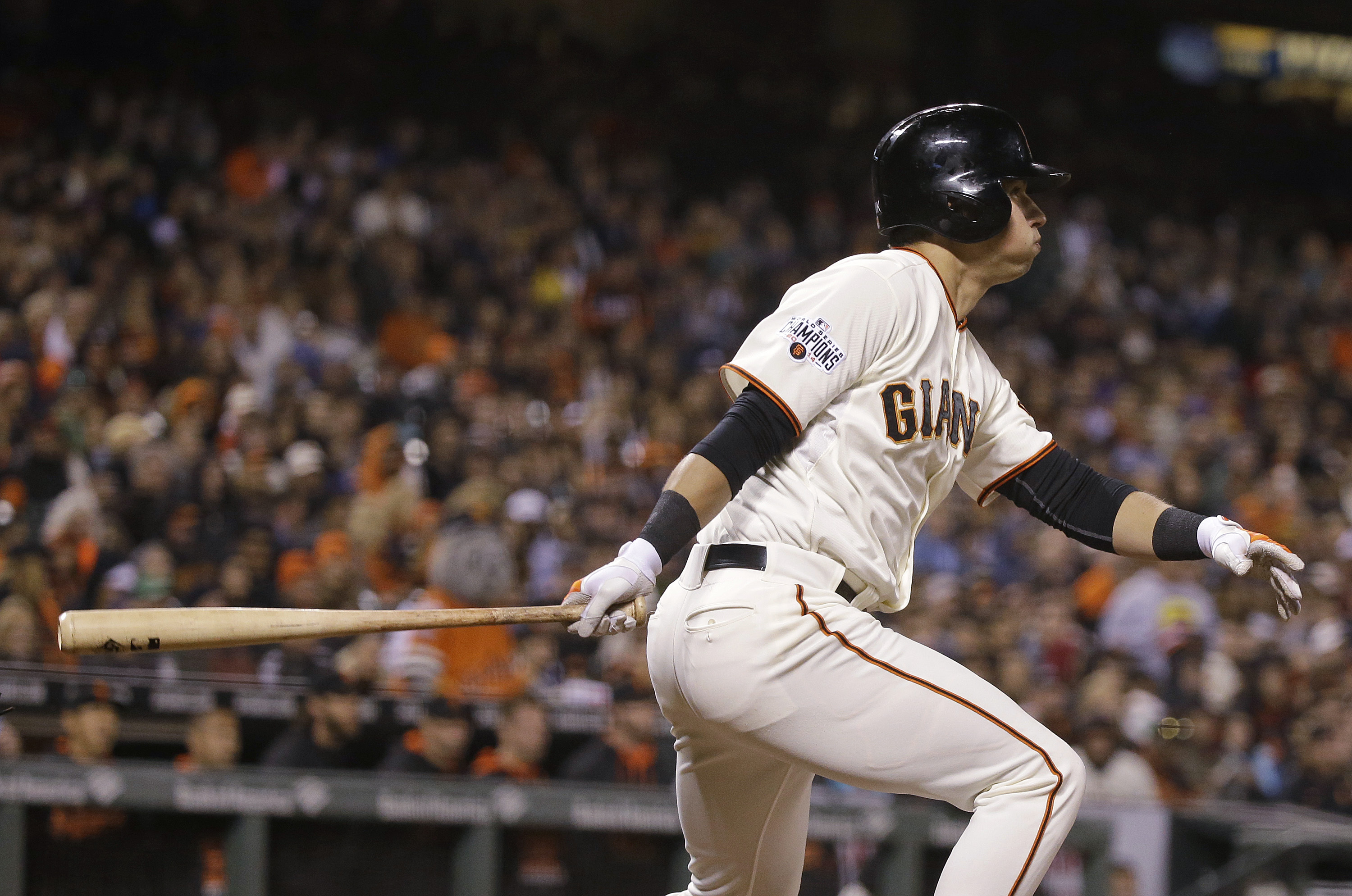 San Francisco Giants' Joe Panik watches his two-run double off Atlanta Braves relief pitcher Brandon Cunniff during the eighth inning of a baseball game Thursday, May 28, 2015, in San Francisco. (AP Photo/Eric Risberg)