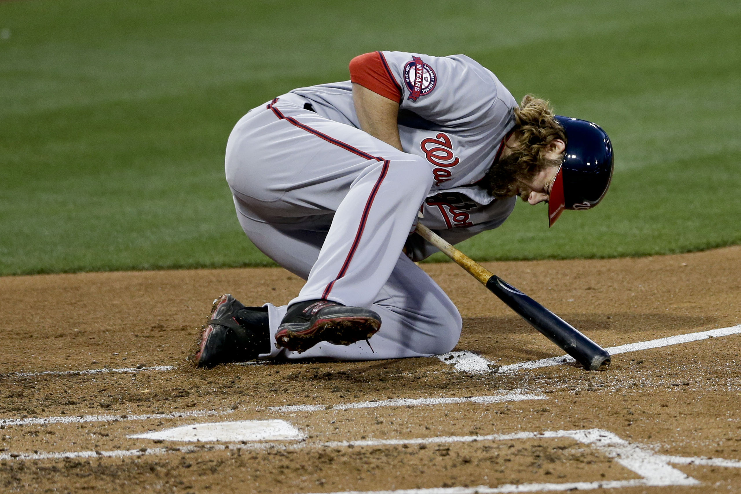 Washington Nationals' Jayson Werth falls after being hit by a pitch while playing the San Diego Padres during the second inning in a baseball game Friday, May 15, 2015, in San Diego. (AP Photo/Gregory Bull)
